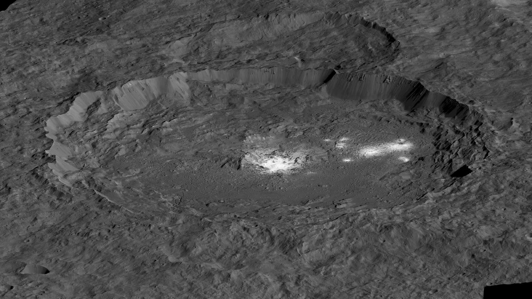 A view of the bright spots of the dwaf planet Ceres' Occator Crater. Cerealia Facula lies in the middle, while Vinalia Faculae is off to the right.