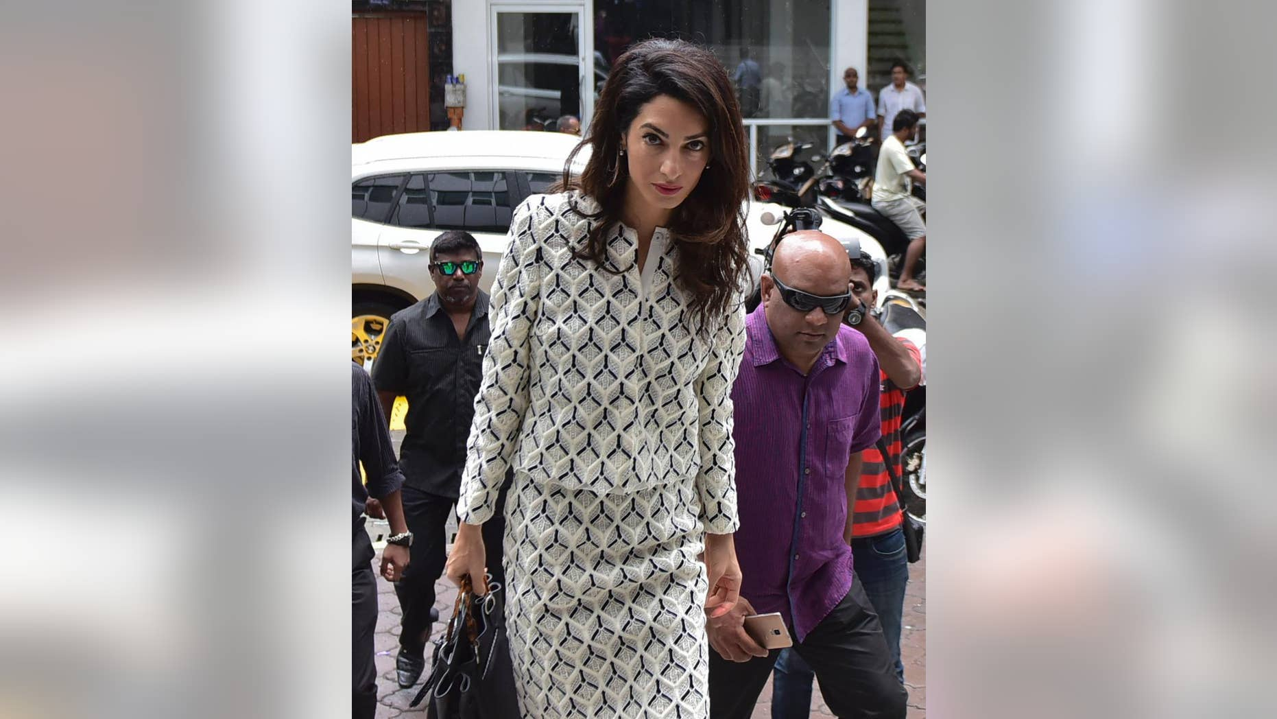 Human rights lawyer Amal Clooney arrives to meet with Attorney General Mohamed Anil at Velaanaage Attorney Generals Office in Male, Maldives, Wednesday, Sept. 9, 2015. Clooney attended a hearing Wednesday to appeal a 13-year jail sentence given to  Maldives' former president Mohamed Nasheed and met with the attorney general to discuss the case. She is part of a three-member international legal team trying to secure Nasheed's release.(AP Photo/ Mohamed Sharuhaan)