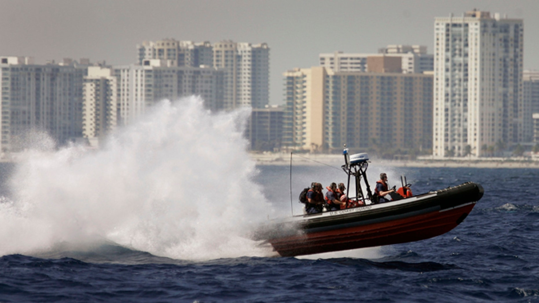 A U.S. Coast Guard boat participates in the Homeland Security Task Force Southeast  mass migration drill March 8, 2007 off the shore of  Miami, Florida. (Photo by Joe Raedle/Getty Images)
