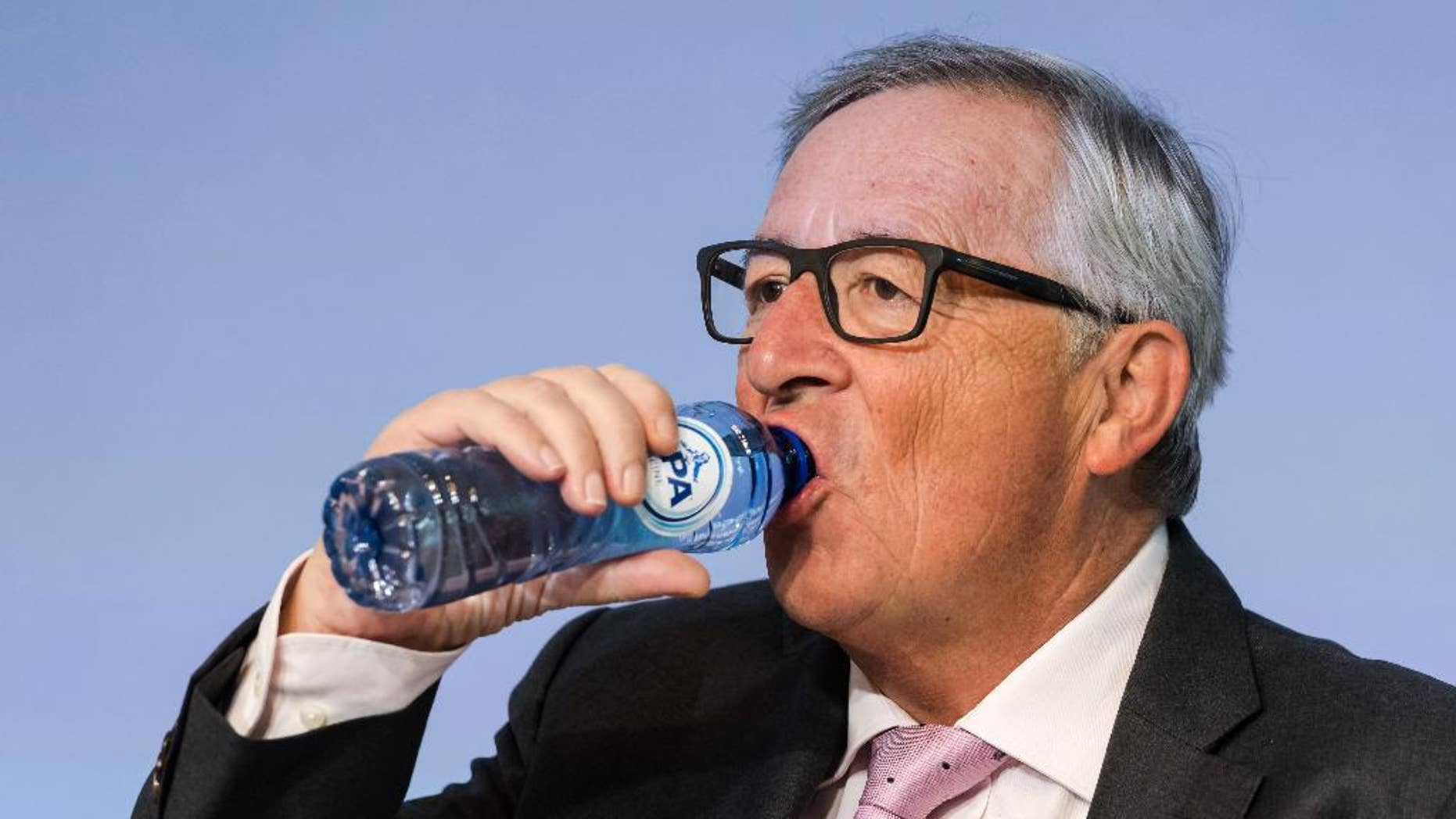European Commission President Jean-Claude Juncker drinks water as he attends a plenary session of European Economic and Social Committee at the EU Charlemagne building in Brussels Thursday, Sept. 22, 2016. (AP Photo/Geert Vanden Wijngaert)