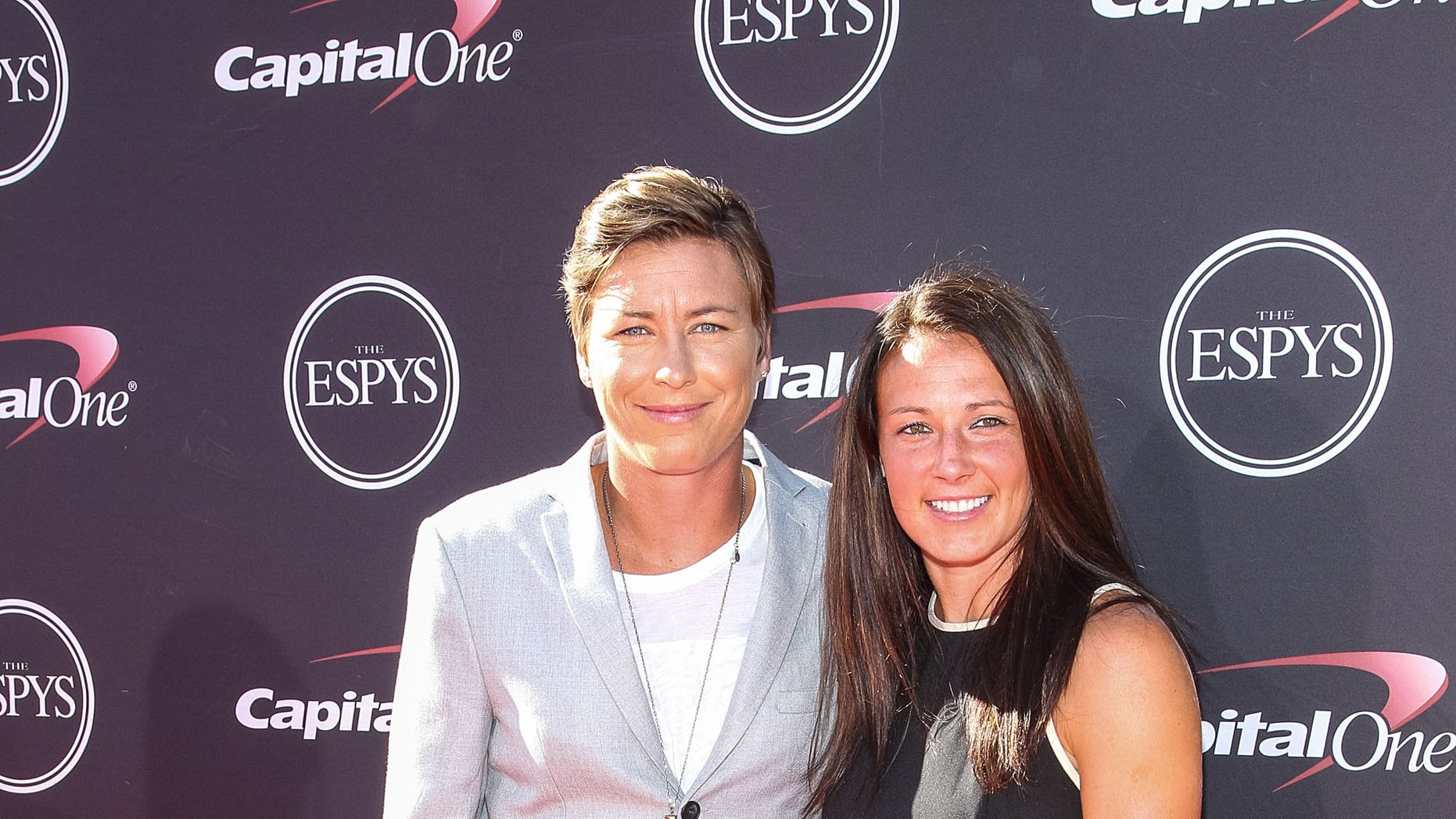 FILE - In this July 17, 2013, file photo, soccer players Abby Wambach, left, and Sarah Huffman arrive for the ESPY Awards in Los Angeles. Wambach's marriage to partner and professional teammate Sarah Huffman instantly made her one of the highest-profile athletes in the national debate over same sex-marriage.  (AP Photo/Invision, Paul A. Hebert, File)