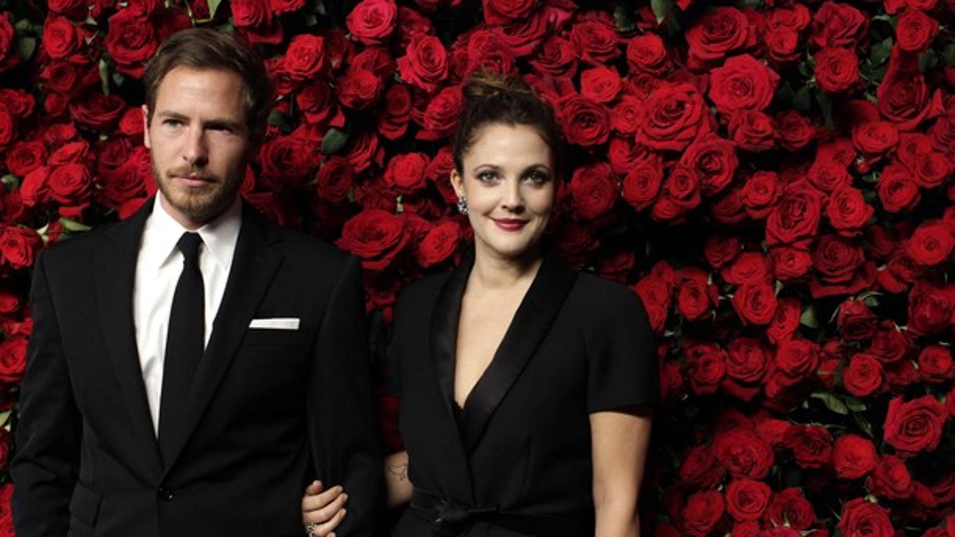 Nov. 15: Actress Drew Barrymore (R) and Will Kopelman (L) attend the Museum of Modern Art's fourth annual Film Benefit in New York. (REUTERS)