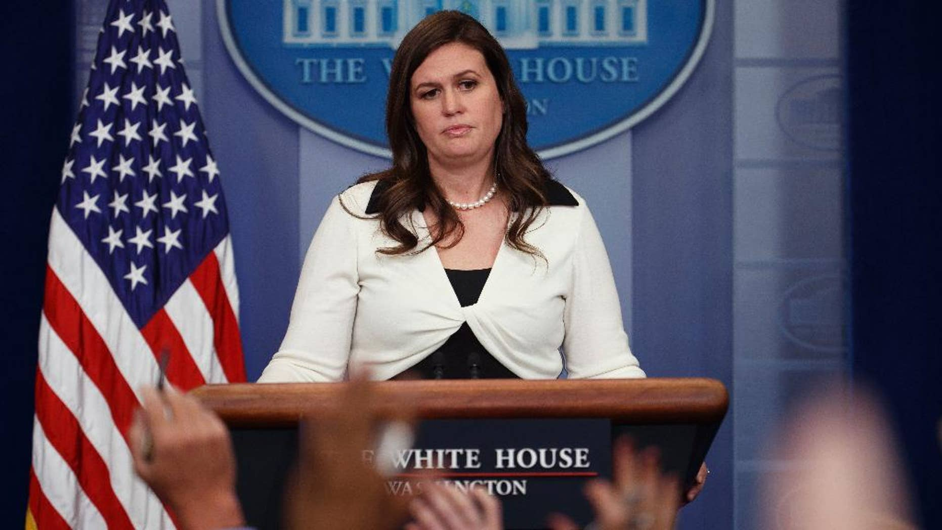 White House deputy press secretary Sarah Huckabee Sanders addresses reporters. Audio and video recordings have been prohibited at daily briefings since June 29.