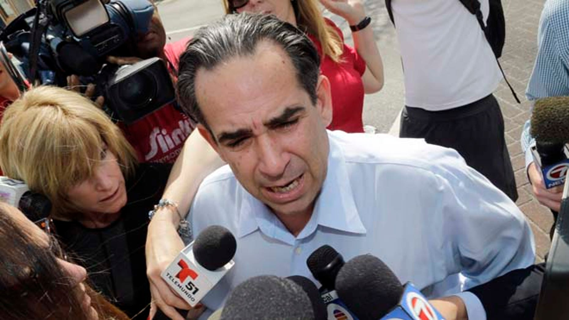 Feb. 17: Anthony Bosch talks to reporters as he prepares to turn himself in at federal court in Miami.