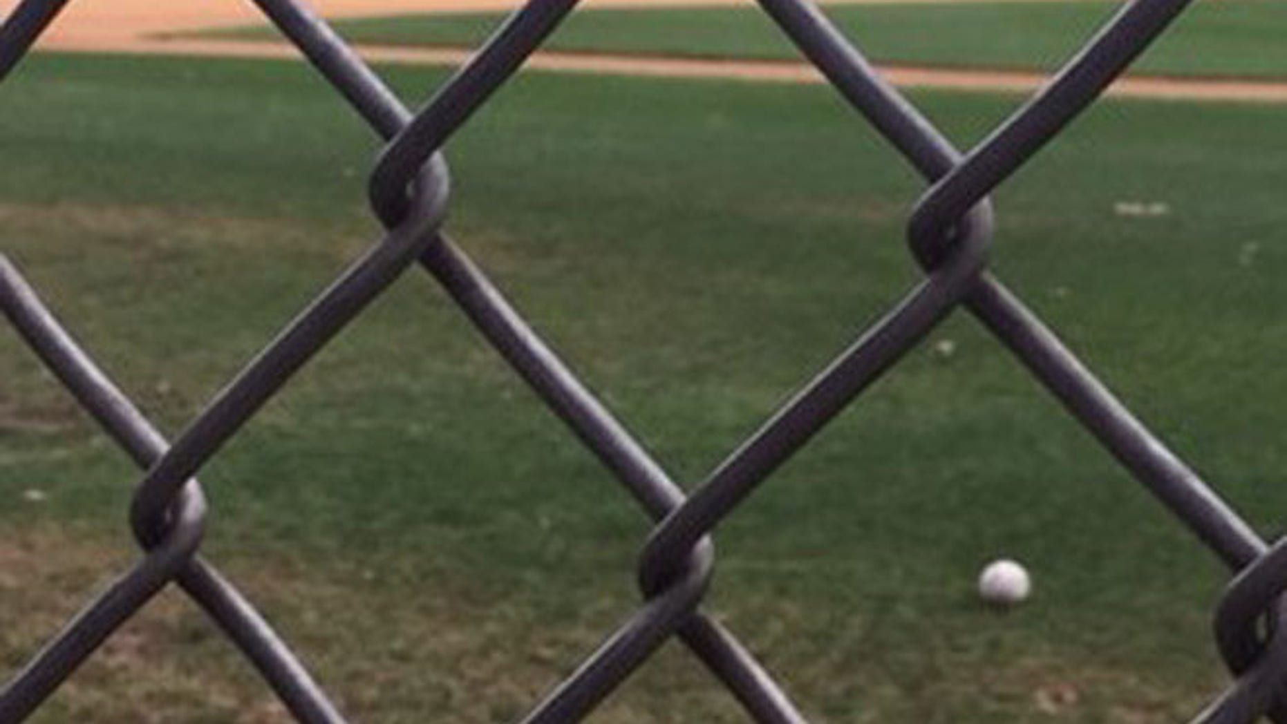 A baseball rests on the Alexandria, Va., field where a congressional baseball practice was attacked.