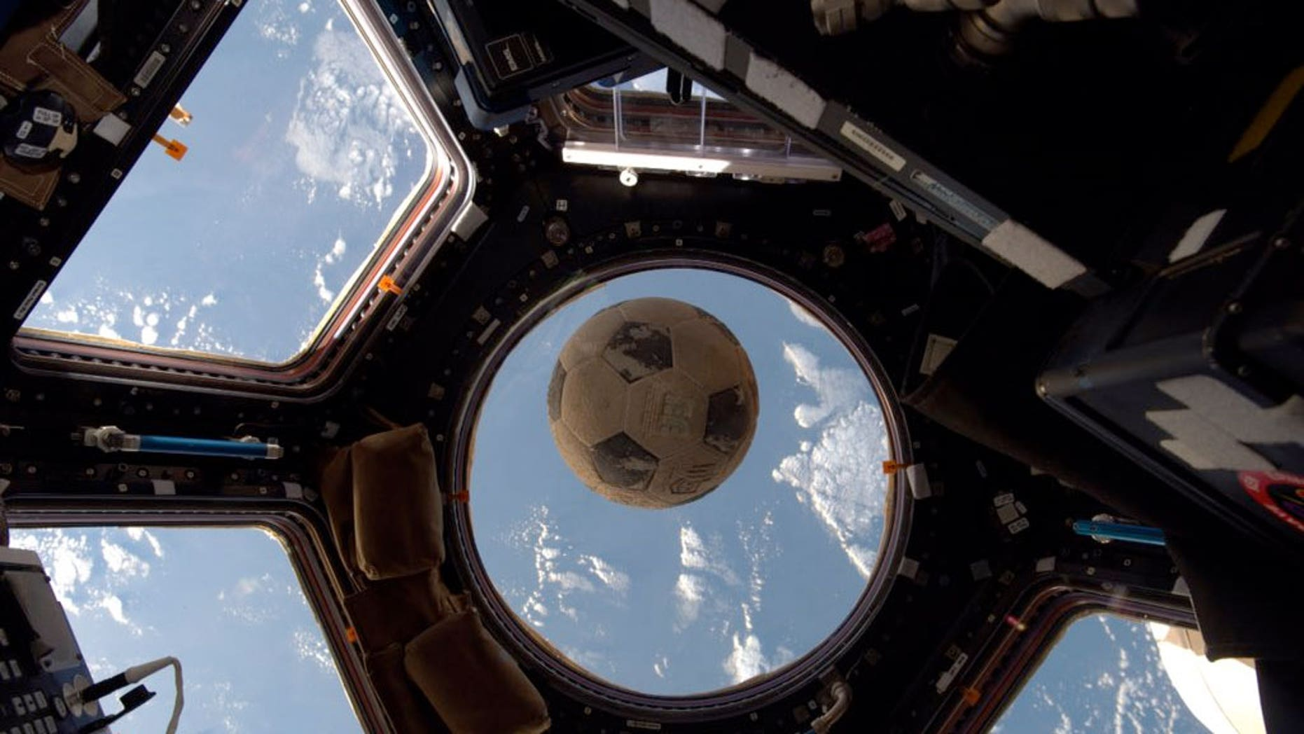 A soccer ball flown aboard the ill-fated launch of the space shuttle Challenger floats on the International Space Station.