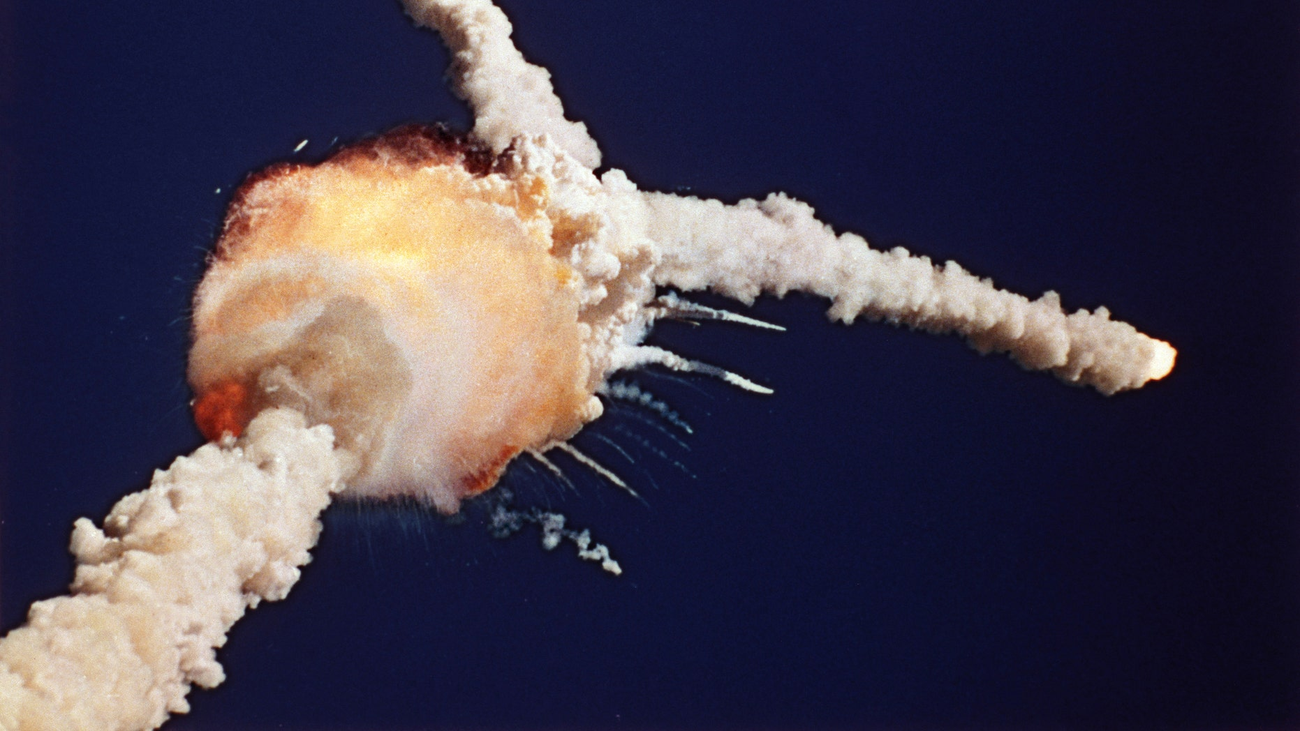 FILE - In this Jan. 28, 1986 file photo, the Space Shuttle Challenger explodes shortly after lifting off from Kennedy Space Center, in Fla. All seven crew members died in the explosion, which was blamed on faulty o-rings in the shuttle's booster rockets.(AP Photo/Bruce Weaver, File)