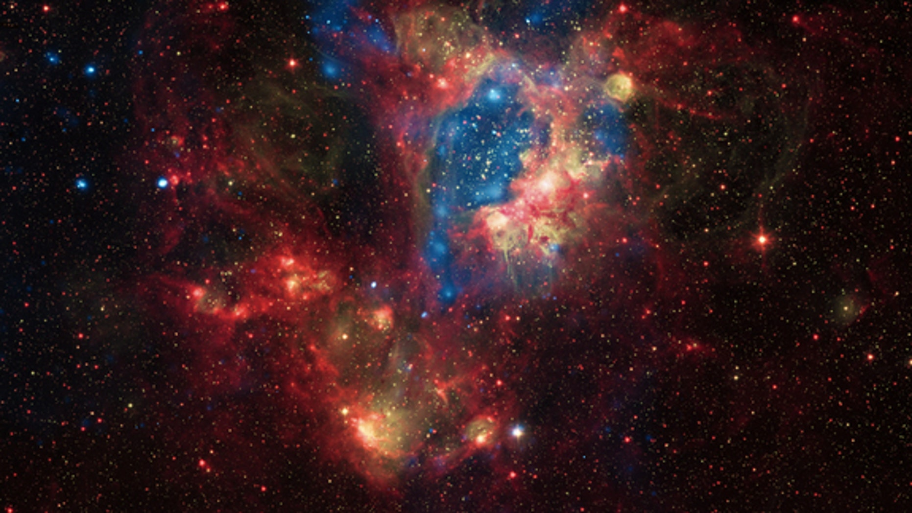 This superbubble in the N44 nebula inside the Large Magellanic Cloud was carved out by exploding stars. The photo, released in August 2012, comes from the Chandra X-ray Space Telescope, combined with data collected by observatories covering oth