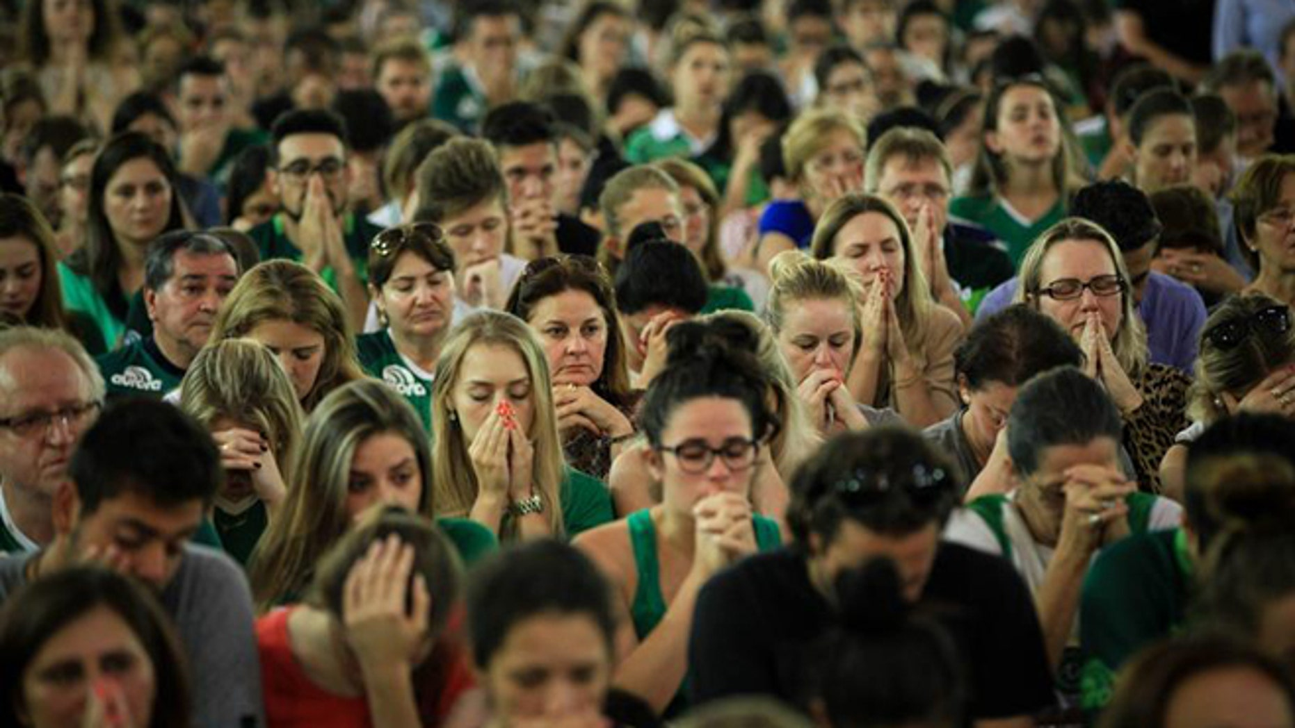 Chapecoense fans attend a mass in Chapeco, Brazil, 29 November 2016. According to reports, 71 people died when an aircraft crashed late 28 November 2016 with 77 people on board, including players of the Brazilian soccer club Chapecoense. Four people registered on the passengers list did not board the plane. The plane crashed in a mountainous area outside Medellin, Colombia as it was approaching the Jose Maria Cordoba airport. The cause of the incident is as yet uknown. Chapecoense were scheduled to play in the Copa Sudamericana final against Medellin's Atletico Nacional on 30 November 2016. (Photo: EPA/Fernando Bizerra Jr.)