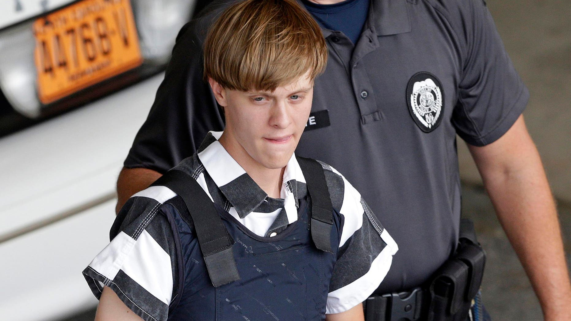 In this June 18, 2015 file photo, Charleston, S.C., shooting suspect Dylann Storm Roof is escorted from the Cleveland County Courthouse in Shelby, N.C