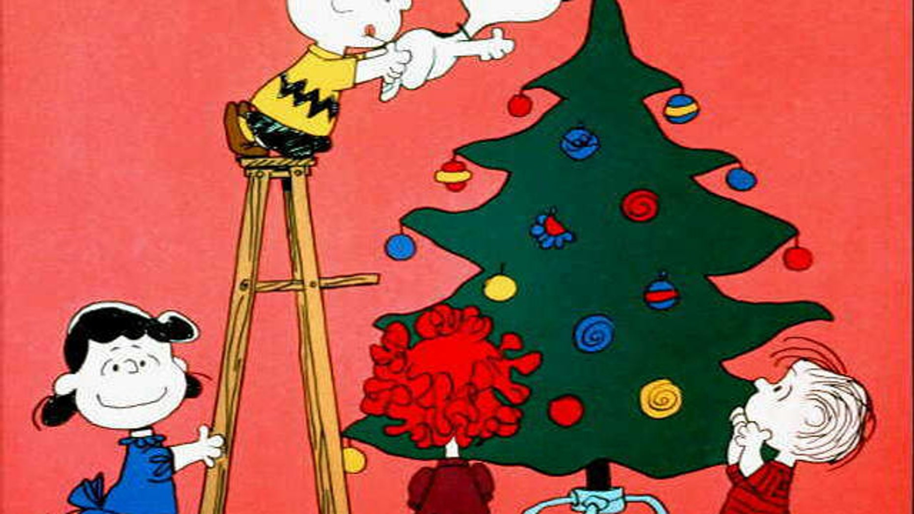 """Lucy, Charlie Brown, Snoopy and Linus in scene from tv special """"A Charlie Brown Christmas."""""""