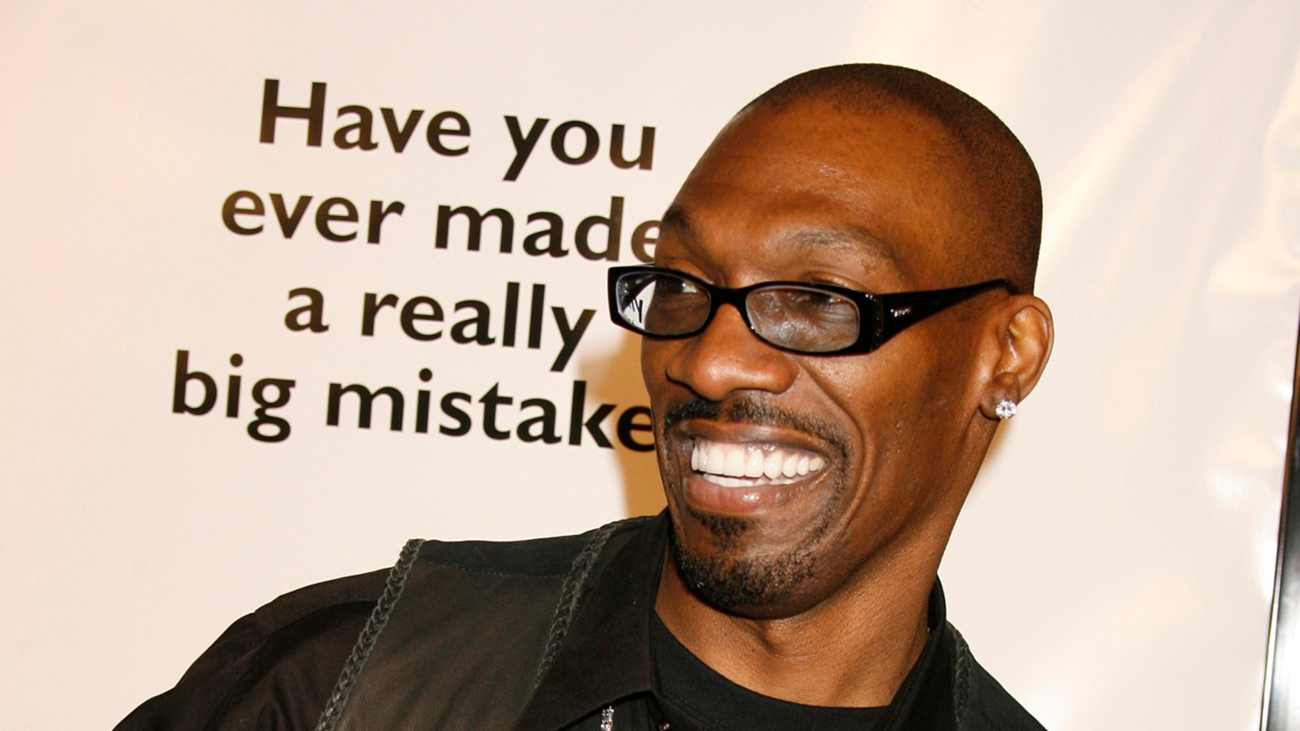 "Charlie Murphy, brother of actor Eddie Murphy, poses at the premiere of the comedy ""Norbit"", starring Eddie Murphy, in Los Angeles February 8, 2007. REUTERS/Fred Prouser  (UNITED STATES) - RTR1M5OZ"