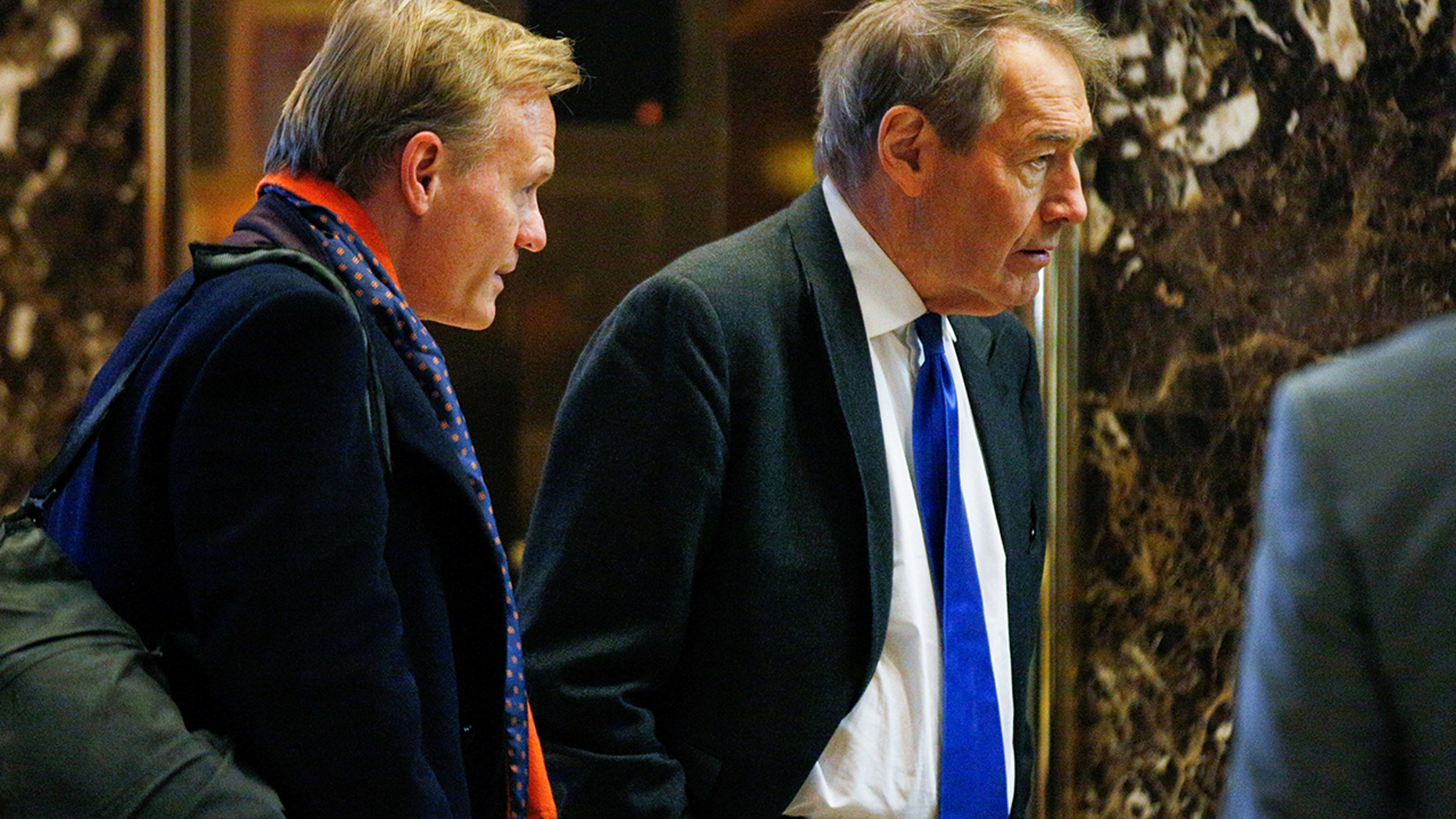 John Dickerson and Charlie Rose arrive to meet with U.S. President-elect Donald Trump at Trump Tower in Manhattan, New York City, Nov. 21, 2016.