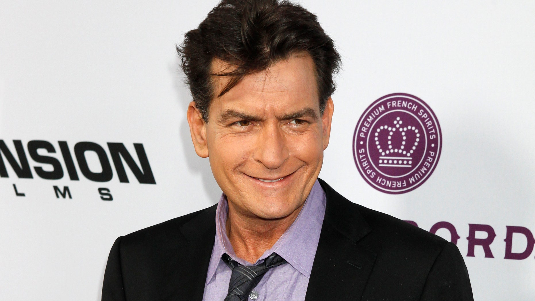 "April 11, 2013. Charlie Sheen poses at the premiere of his new film ""Scary Movie 5"" in Hollywood."