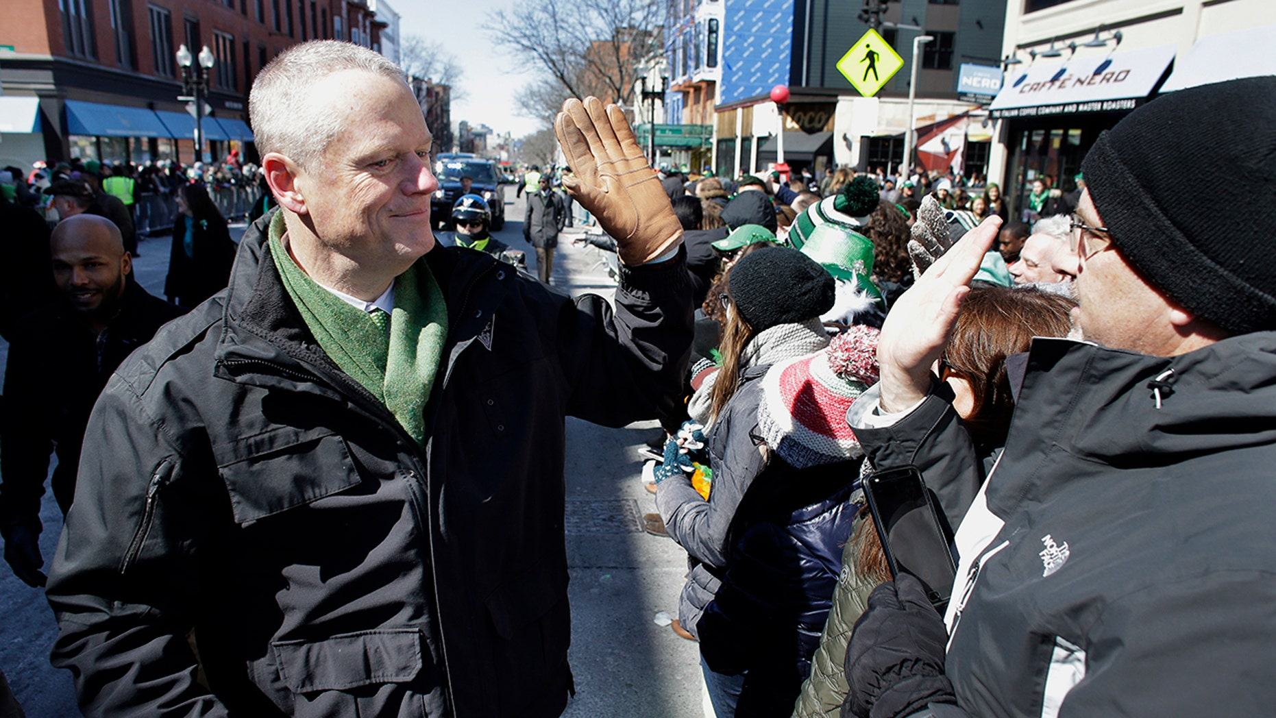 Massachusetts Gov. Charlie Baker shakes hands with constituents at the annual St. Patrick's Day parade in Boston on Sunday.