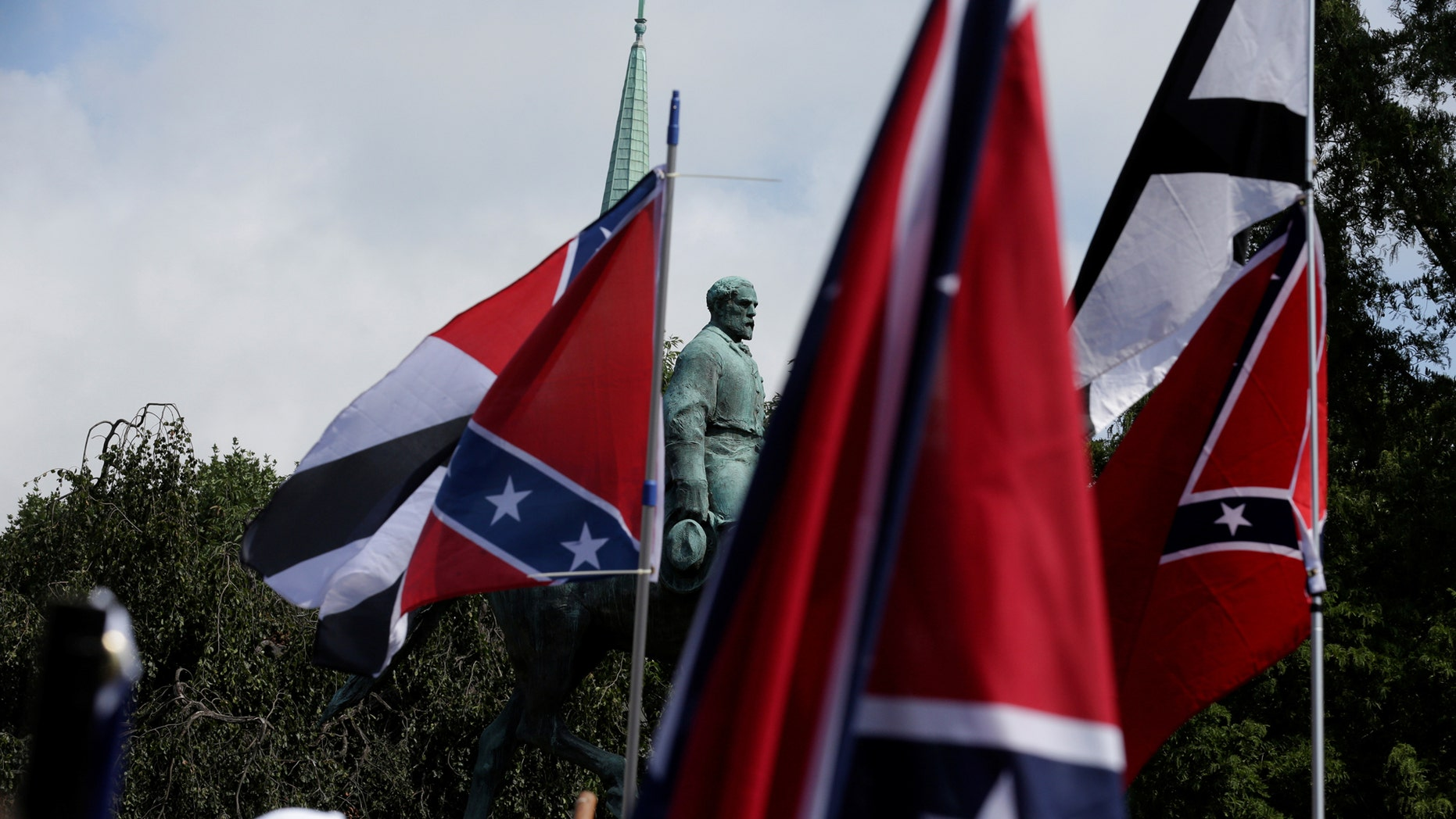 Members of white nationalists rally around a statue of Robert E. Lee in Charlottesville, Va., Aug. 12, 2017.