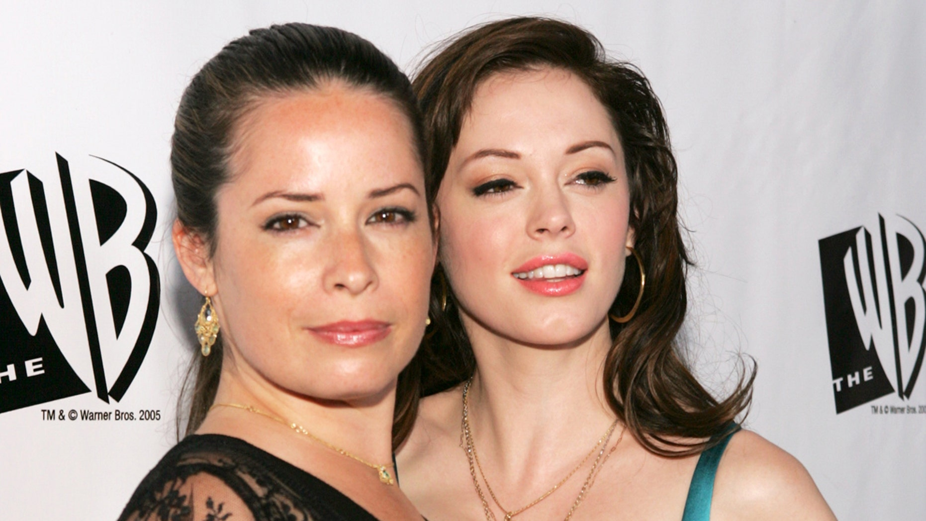 """""""Charmed"""" cast member Holly Marie Combs criticizes new reboot. Here,  Combs (left) with co-star Rose McGowan, arrive for The WB's All-Star Party at the Cabana Club in Hollywood July 22, 2005."""