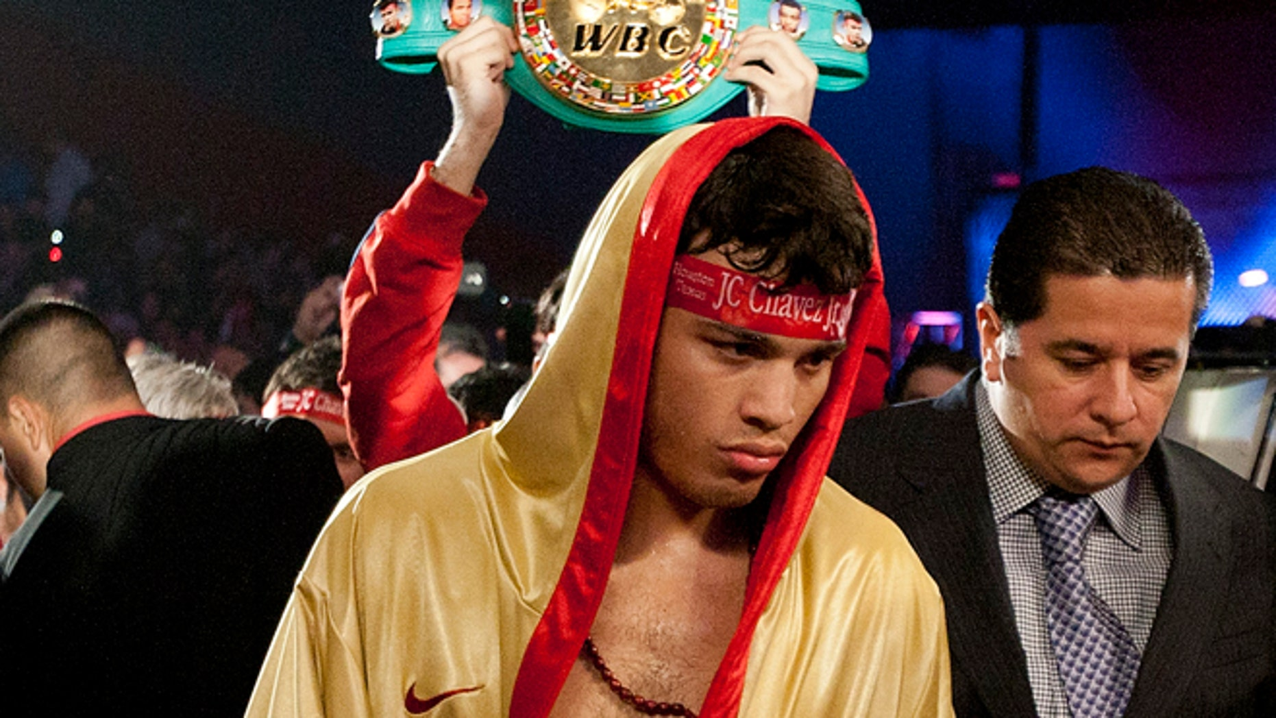 HOUSTON - NOVEMBER 19:  World Middleweight Champion Julio Chavez Jr. makes his way to the ring to defend his belt against Peter Manfredo Jr. at Reliant Arena at Reliant Park on November 19, 2011 in Houston, Texas.  (Photo by Bob Levey/Getty Images)