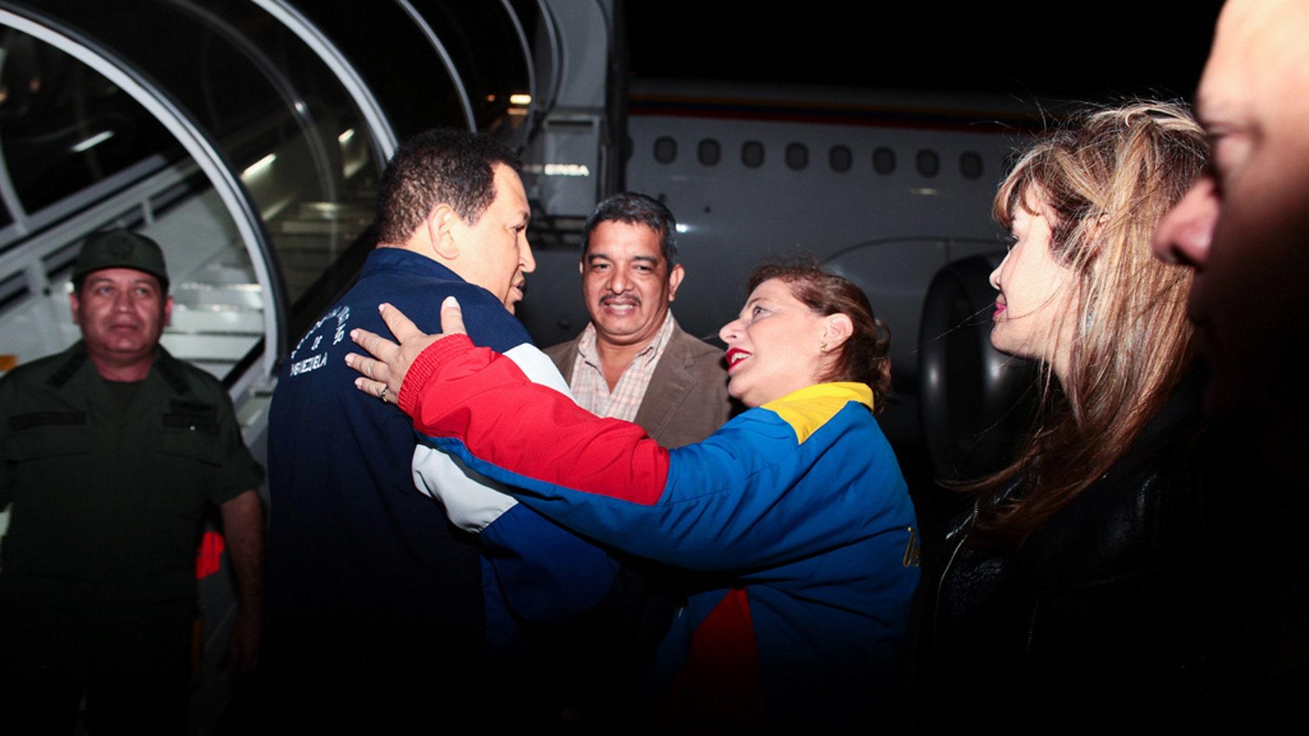 "Venezuelan President Hugo Chávez boards a plane to Cuba for radiation treatment on April 14. (<a href=""http://www.flickr.com/photos/chavezcandanga/6938673310/in/photostream"">Flickr</a>)"