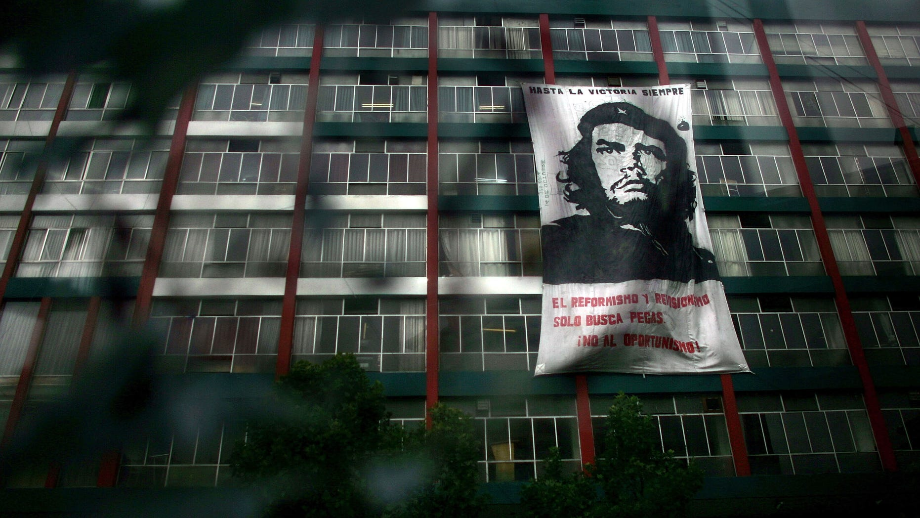 Dec 19:  A picture of Che Guevara, the revolutionarily figure who was killed by the Bolivian Military in 1967, hangs from a building.