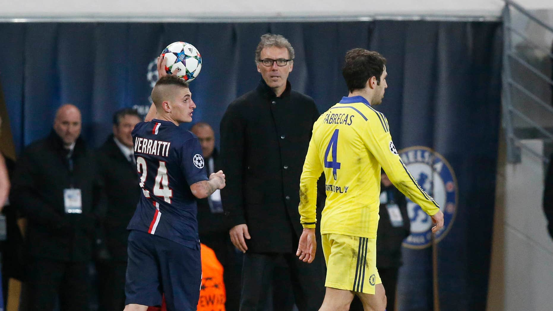 Feb. 17, 2015: PSG's Marco Verratti prepares a throw-in while PSG's head coach Laurent Blanc, center, looks on and Chelsea's Cesc Fabregas, right, passes by during the Champions League round of 16 first leg soccer match between Paris Saint Germain and Chelsea.