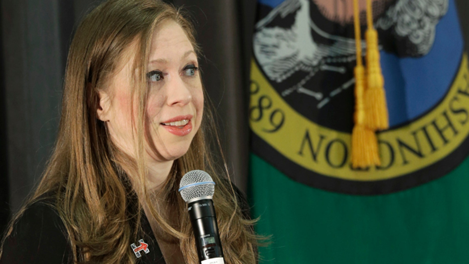 Mar. 22, 2016: Chelsea Clinton, daughter of Democratic presidential candidate Hillary Clinton, speaks next to the Washington state flag at Bates Technical College in Tacoma, Wash.