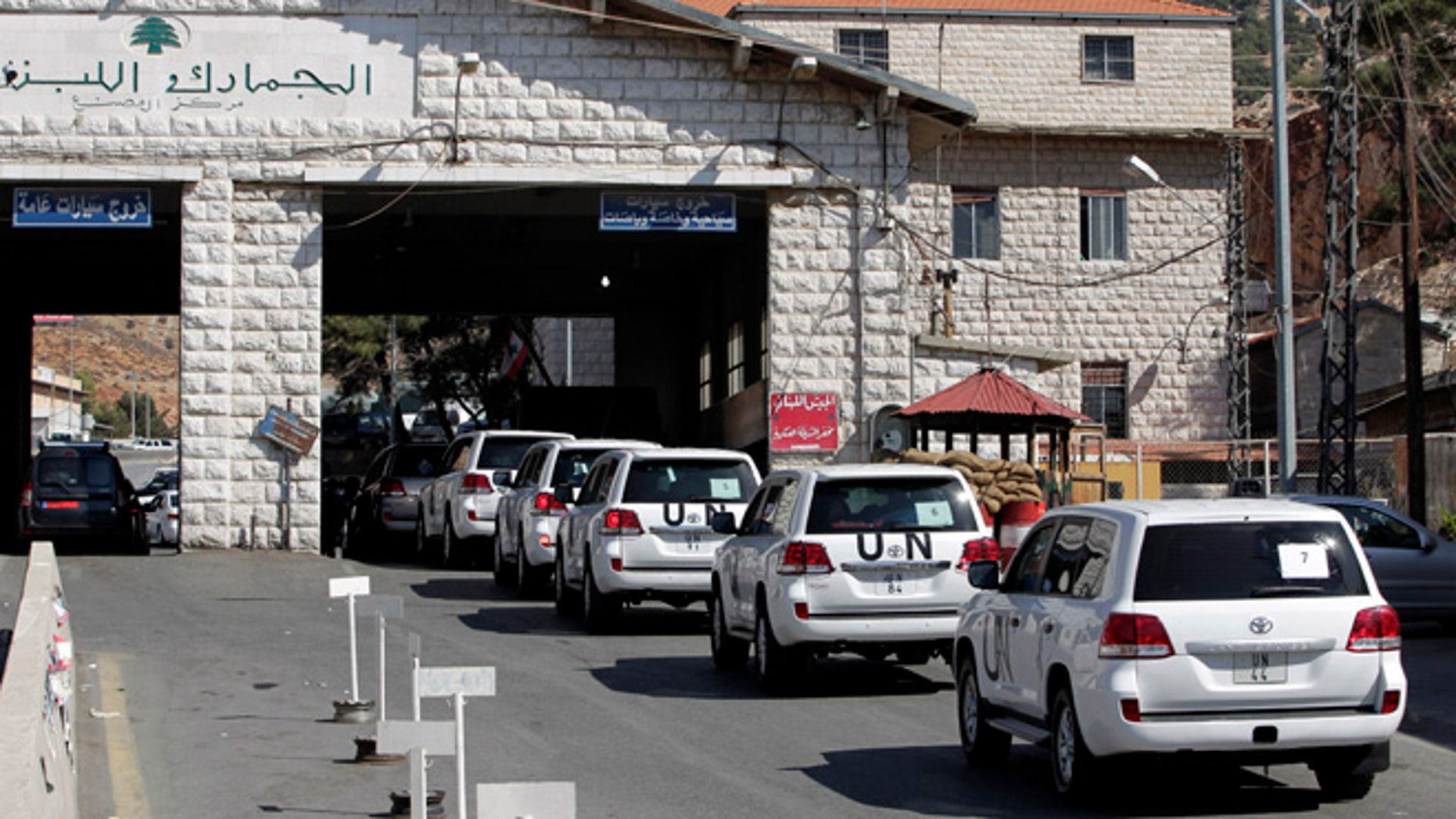 Oct. 1, 2013: A convoy of inspectors from the Organization for the Prohibition of Chemical Weapons prepares cross into Syria at the Lebanese border crossing point of Masnaa, eastern Bekaa Valley, Lebanon.