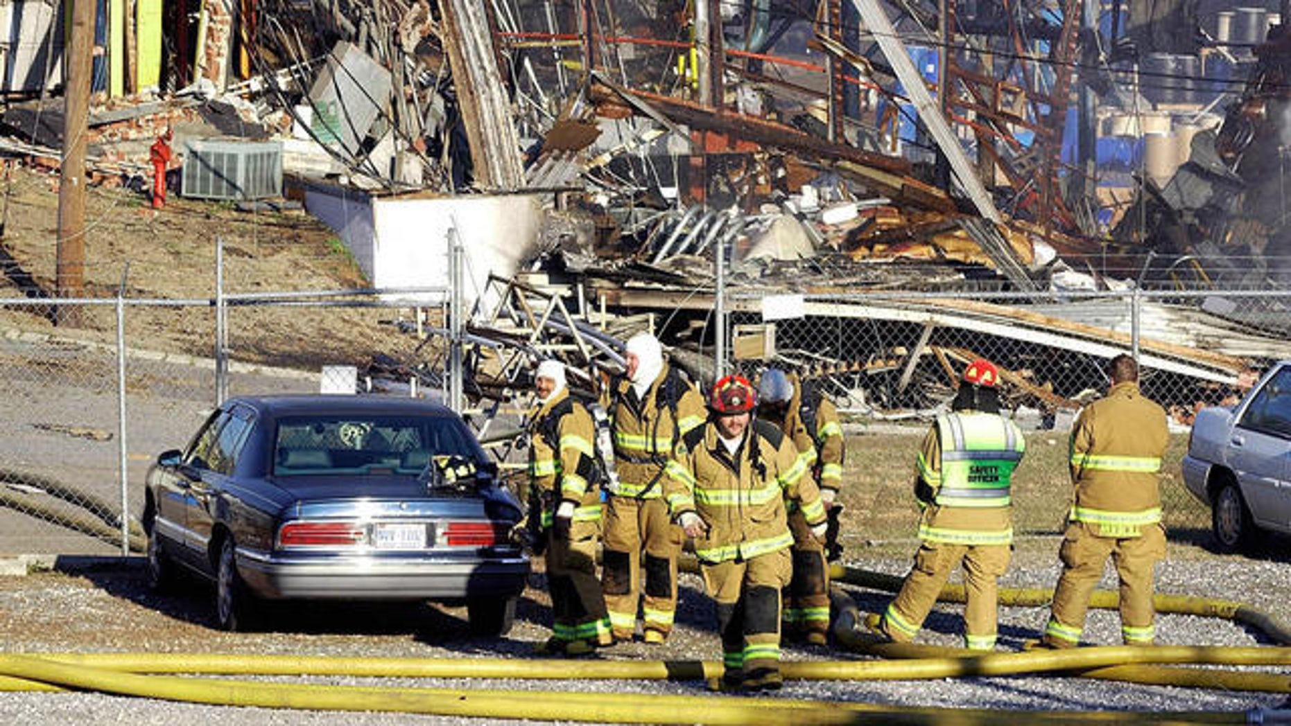 In this 2006 file photo, firefighters wait to go into a debris field at a chemical plant after an explosion and fire in Morganton, N.C.