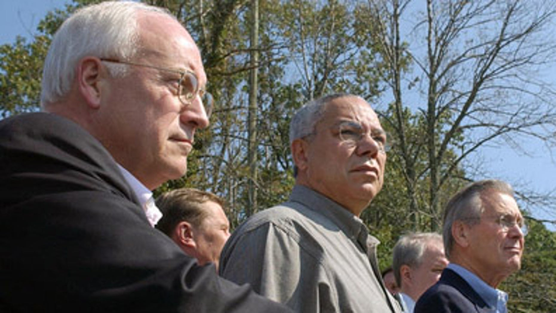 FILE: In this Sept. 27, 2003, photo, then-Vice President Dick Cheney stands with Secretary of State Colin Powell and Secretary of Defense Donald Rumsfeld at Camp David.