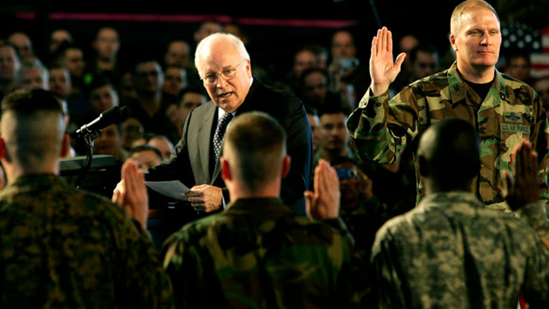 Mar. 21, 2006: U.S. Vice President Dick Cheney leads the reading of an oath with participants in a re-enlistment ceremony for U.S. Air Force Personnel during his visit to Scott Air Force Base in Illinois.