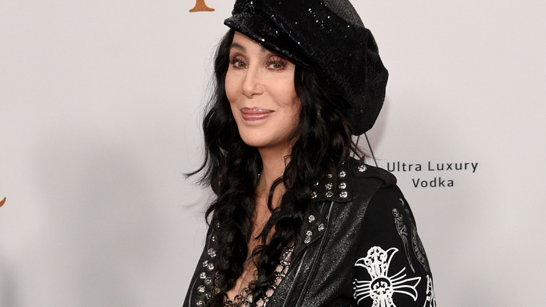 """In this April 12, 2017 file photo, Cher arrives at the premiere of """"The Promise"""" in Los Angeles."""