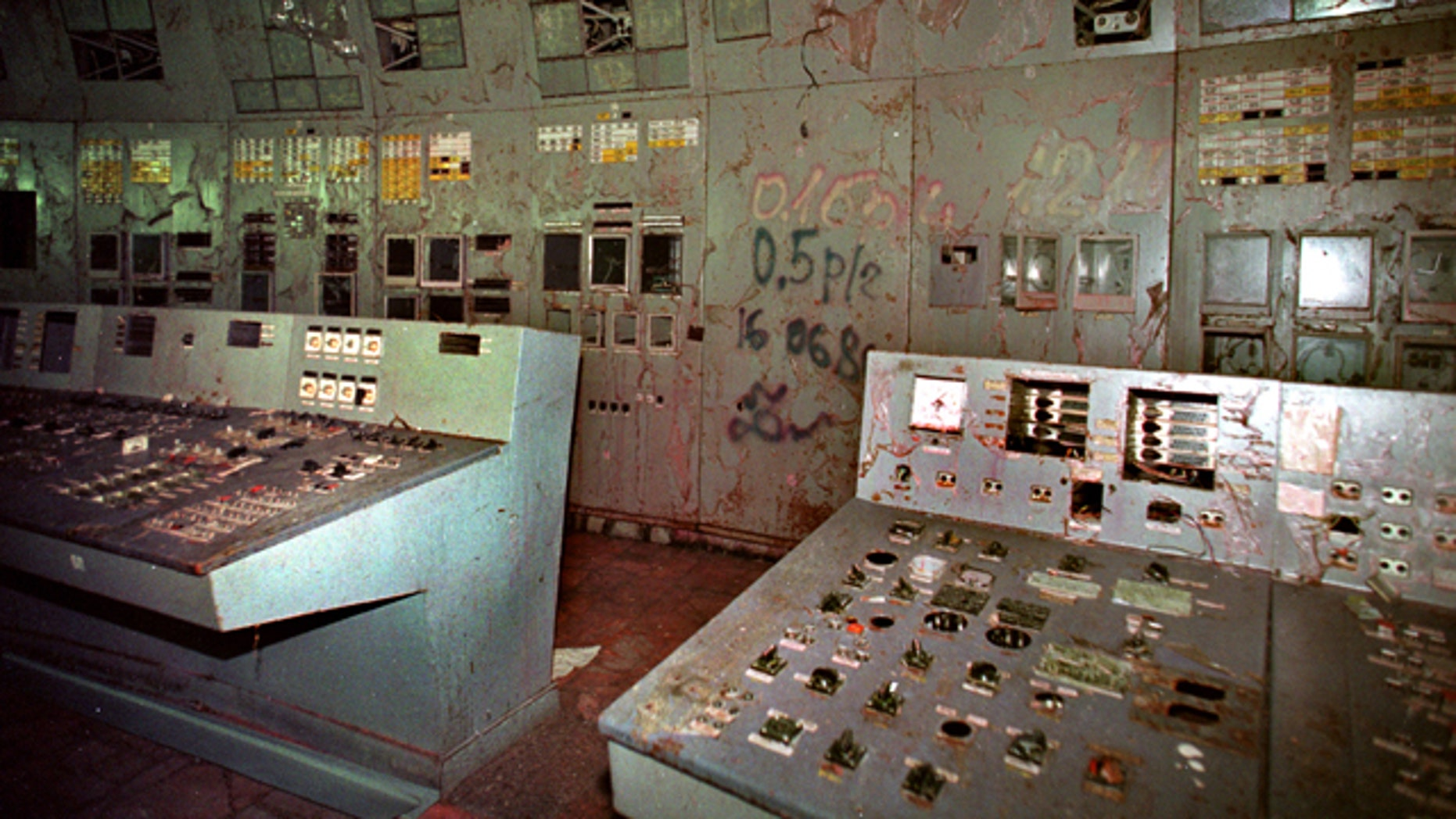 In this Nov. 10, 2000 file photo, the control room, with its damaged machinery, is seen inside reactor No. 4 in the Chernobyl nuclear power plant. Geiger counters registered about 80,000 microroentgens an hour, 16,000 times the safe limit. Reactor No. 4 at the Chernobyl nuclear power plant in Ukraine, then part of the Soviet Union, exploded on April 26, 1986, sending a cloud of radiation over much of Europe. (AP)