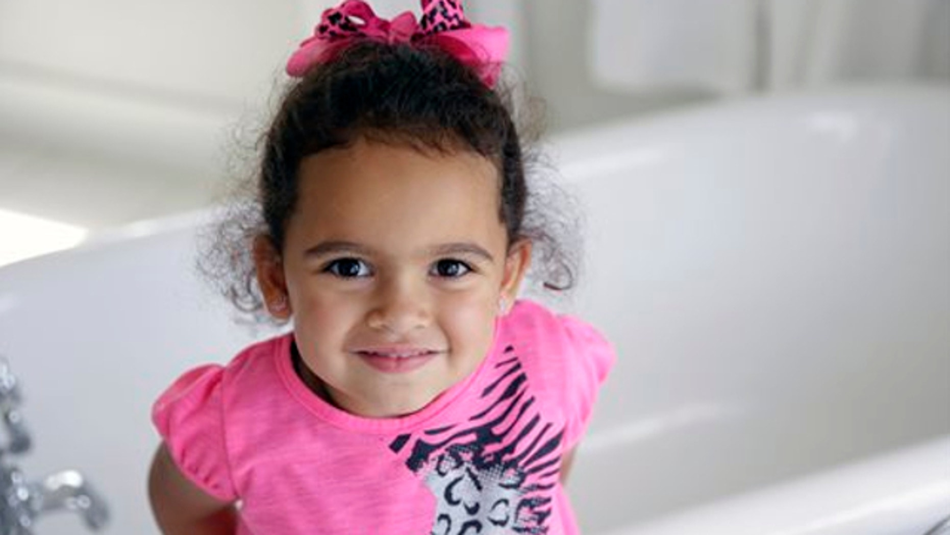 Aug. 6, 2013: Veronica, the 4-year-old Cherokee girl at the center of an adoption dispute, smiles in a bathroom of the Cherokee Nation Jack Brown Center in Tahlequah, Okla.