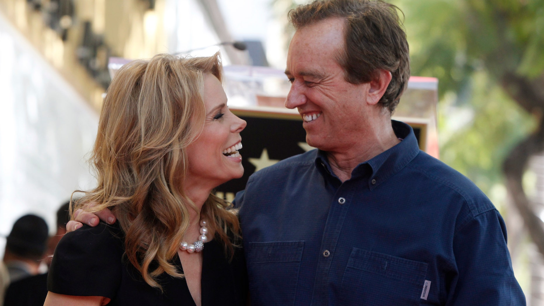 January 29, 2014. Actress Cheryl Hines (L) smiles at her boyfriend Robert F. Kennedy Jr. during ceremonies honoring Hines with a star on the Hollywood Walk of Fame in Hollywood, California.