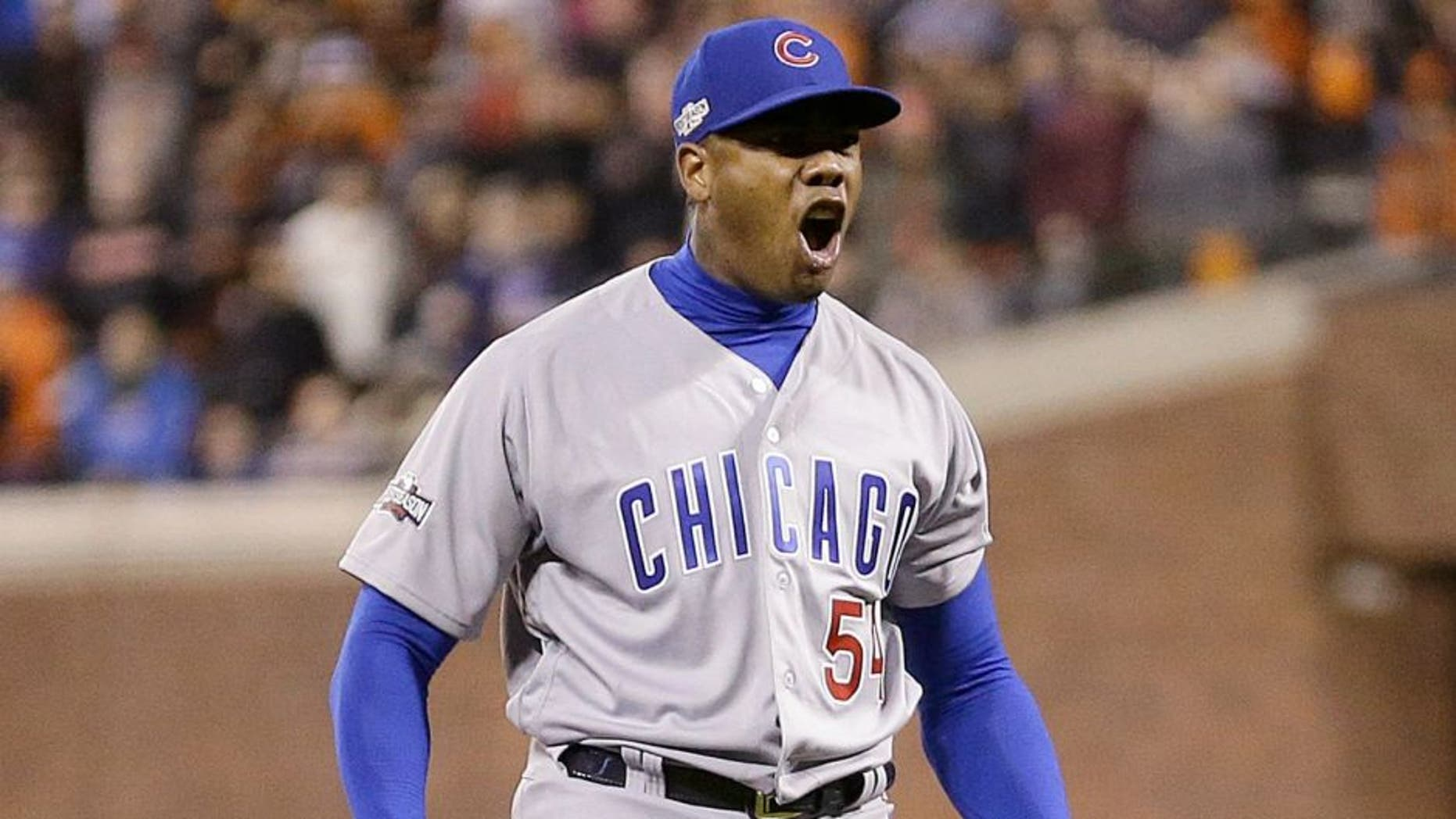 Chicago Cubs pitcher Aroldis Chapman (54) celebrates after Game 4 of baseball's National League Division Series against the San Francisco Giants in San Francisco, Tuesday, Oct. 11, 2016. The Cubs won 6-5. (AP Photo/Ben Margot)