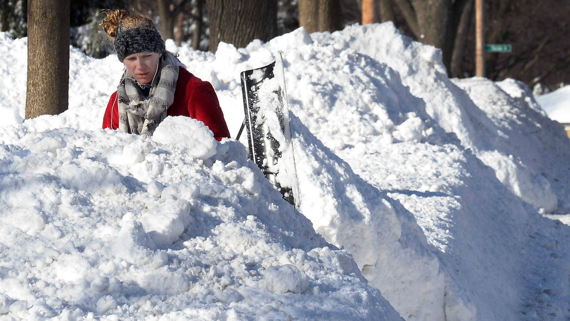 Feb. 2, 2015: Lauren Rosengarden of Mount Prospect, Ill. digs out her driveway.