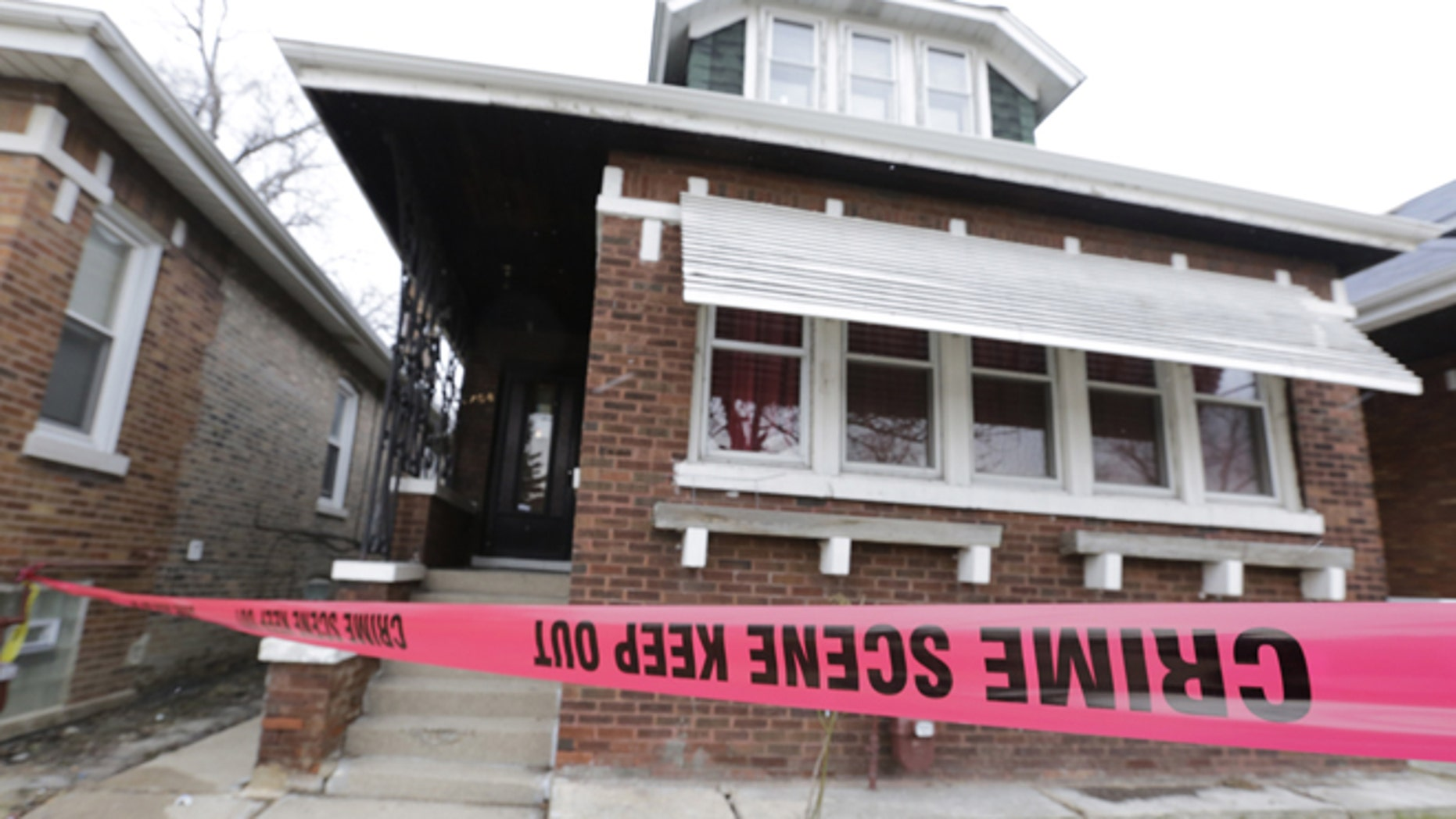 Feb. 5, 2016,: Crime scene tape surrounds a home in Chicago. (AP Photo/M. Spencer Green)