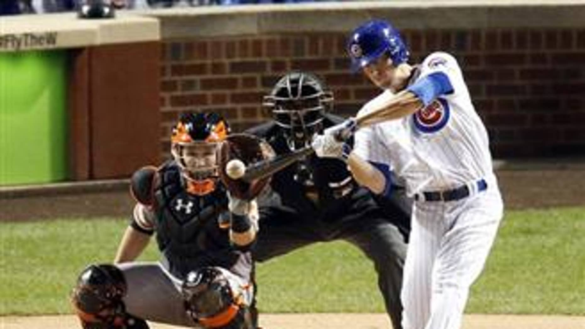 Chicago Cubs' Kris Bryant hits a double in the fourth inning of Game 1 of baseball's National League Division Series against the San Francisco Giants, on Oct. 7, 2016, in Chicago.