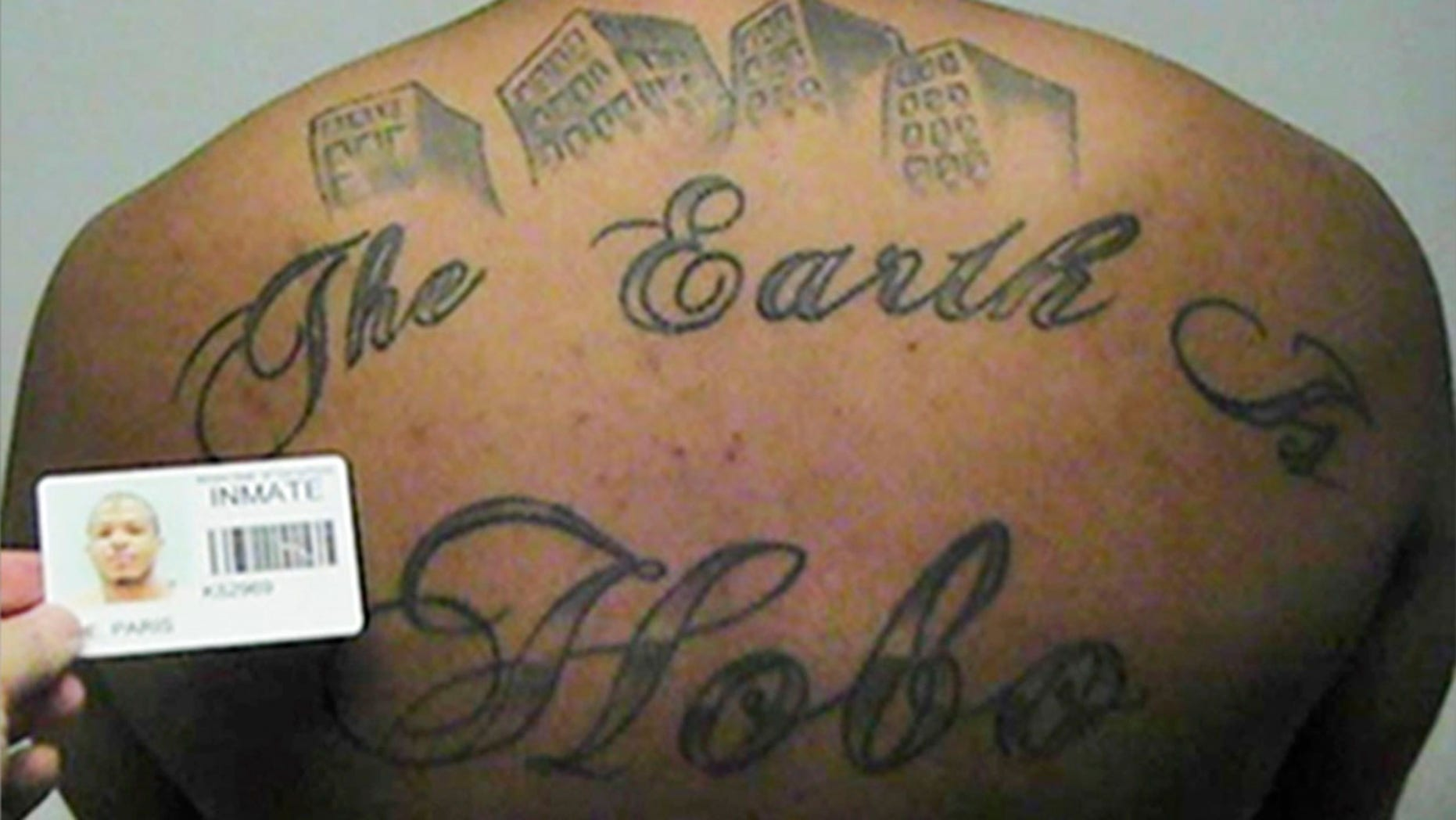 """This undated file photo shows Paris Poe's back tattoo that reads """"The Earth Is Our Turf"""", and Hobo."""
