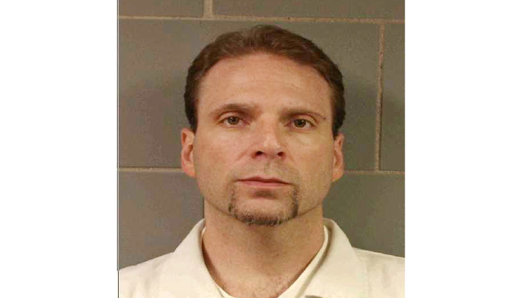 This undated file photo provided by the FBI shows  Kenneth Conley, one of two inmates who escaped from the Metropolitan  Correctional Center in downtown Chicago on Dec. 18, 2012.