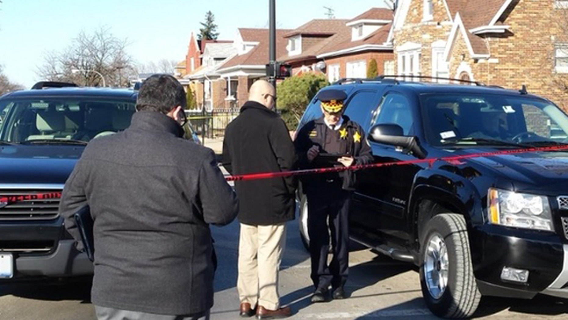 Chicago police at the scene where six people were found dead Thursday afternoon.