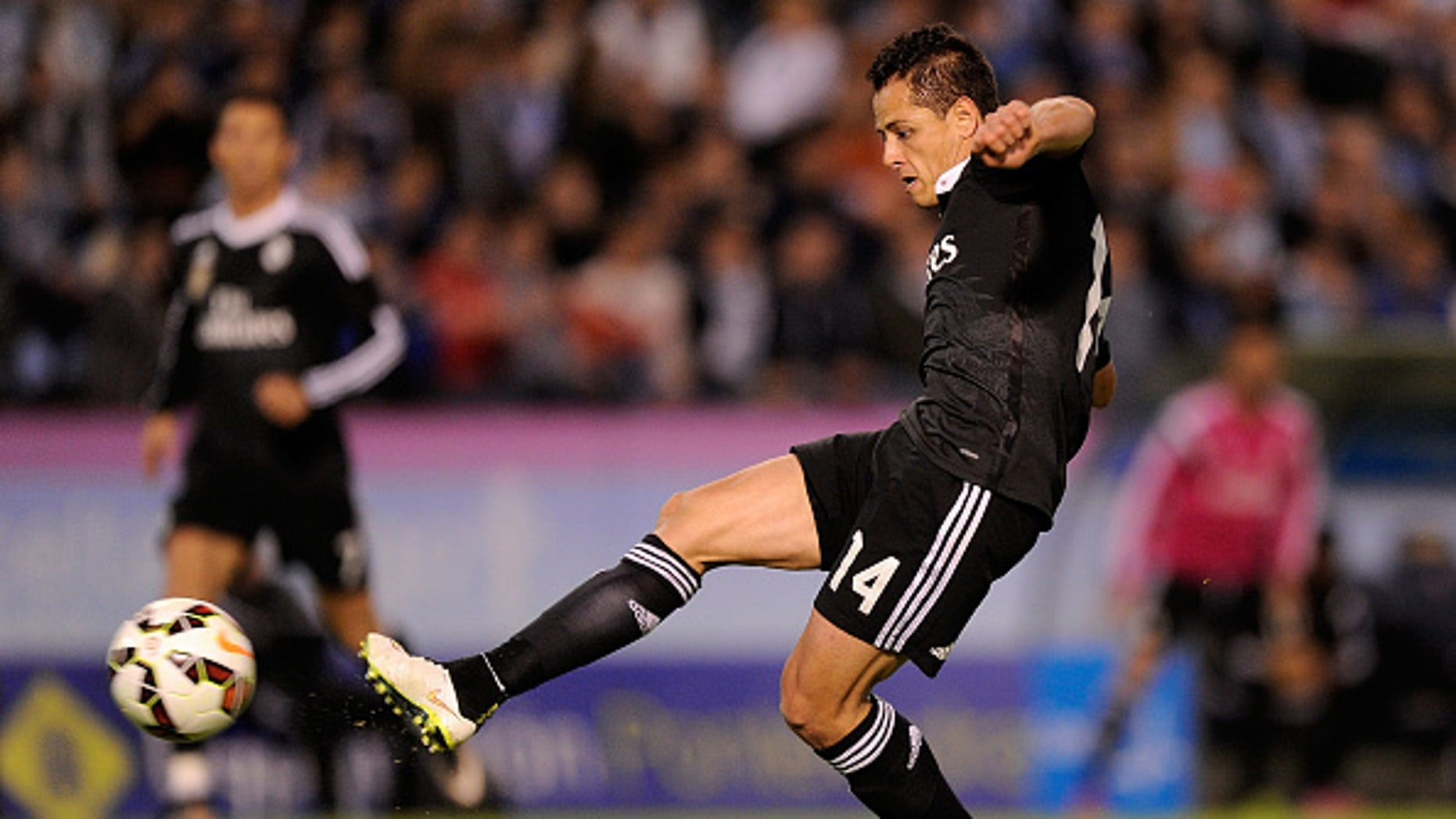 VIGO, SPAIN - APRIL 26:  Javier & Chicharito Hernandez of Real Madrid scores Real's 4th goal during the La Liga match between Celta Vigo and Real Madrid CF at Estadio Balaidos in Vigo, Spain.