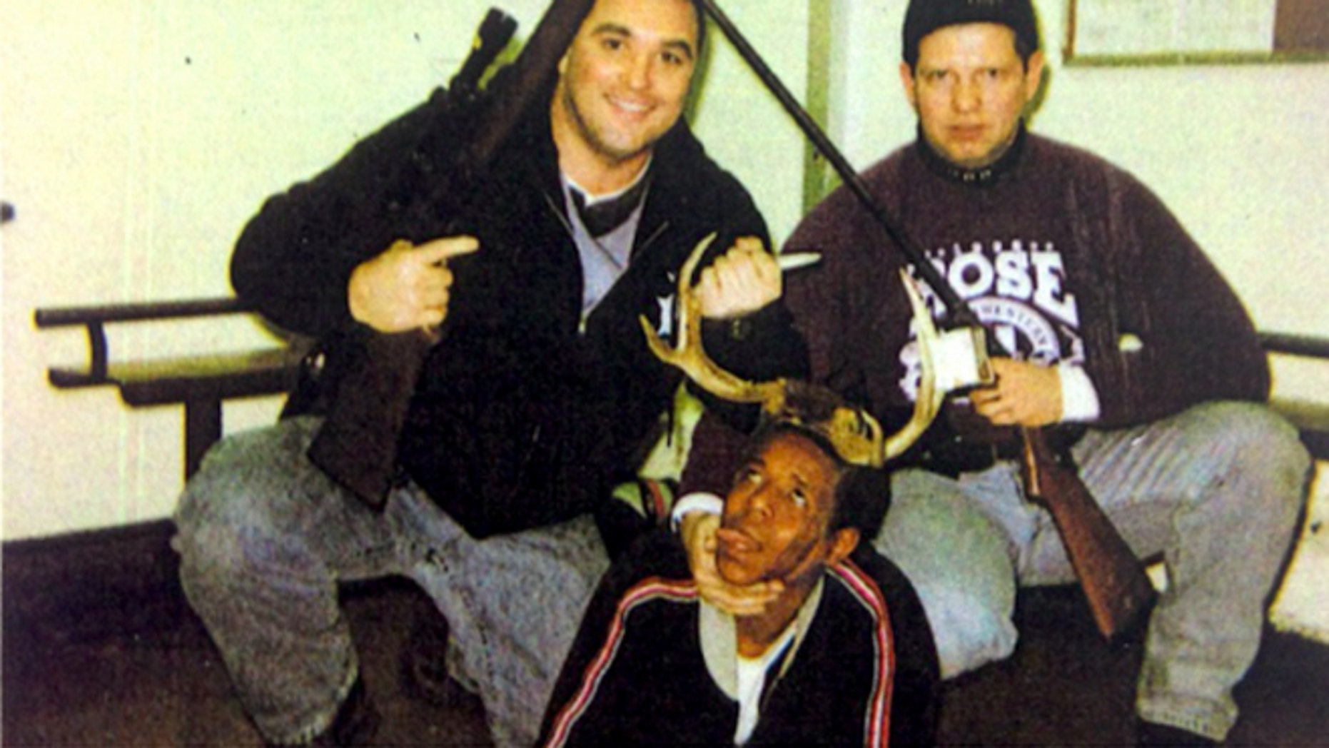 Officers Jerome Finnigan, left, and Tim McDermott with unidentified man
