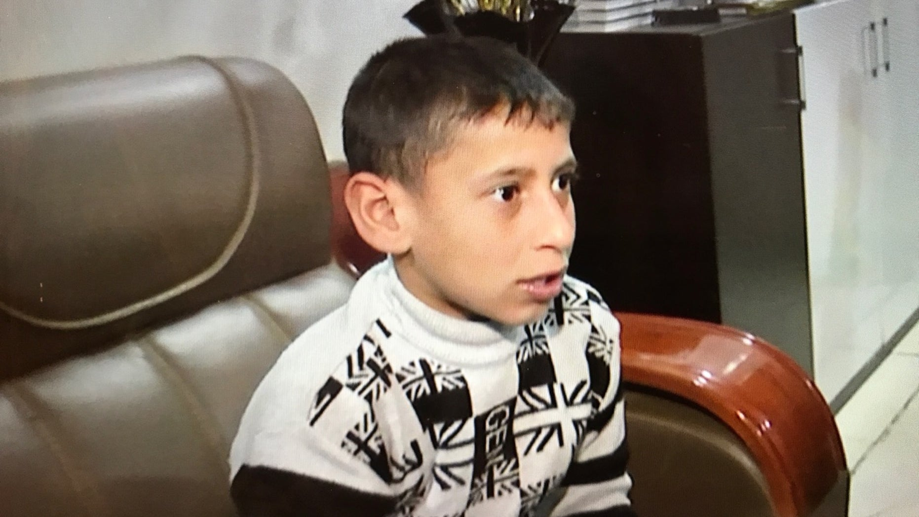 Akram, 8, was a prisoner of ISIS for two and a half years.