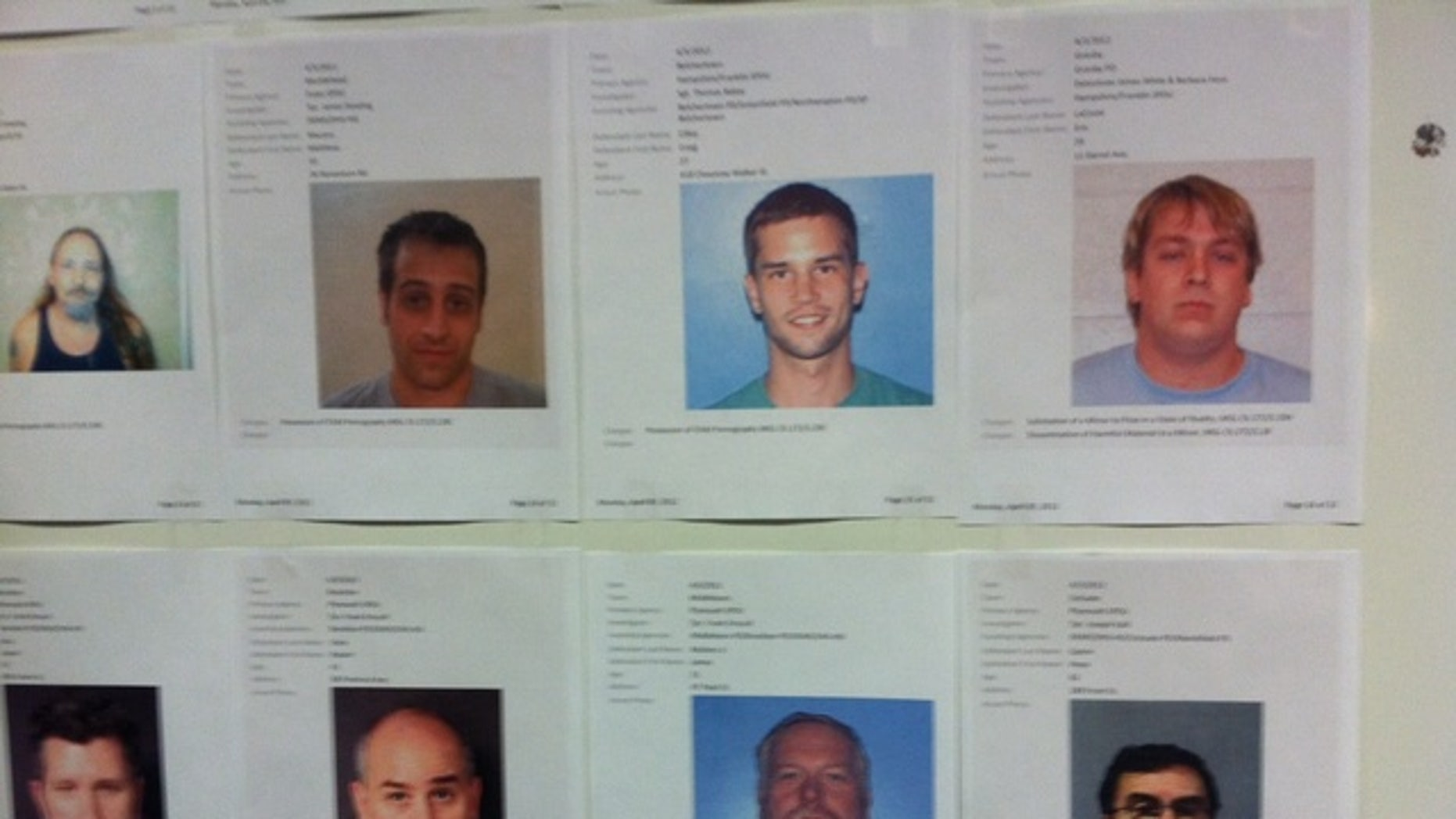 April 10, 2012: Mugshots of those arrested were posted on the walls of Massachusetts State Police Headquarters in Framingham.