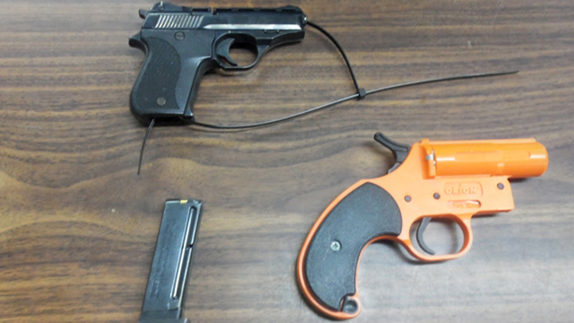 Jan. 17, 2013: This photo provided by the New York City Police Department shows a .22 caliber semi-automatic handgun, top, and a flare gun.