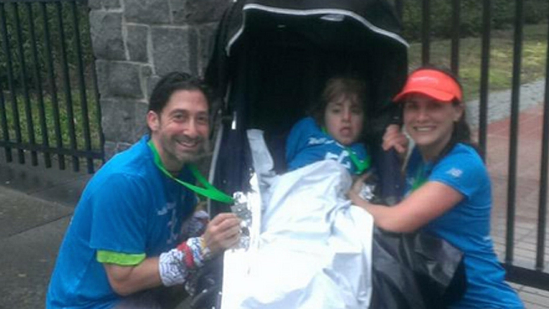 Marjan Holbrook and her daughter Rebecca got a helping hand from nurse Gary Harris.