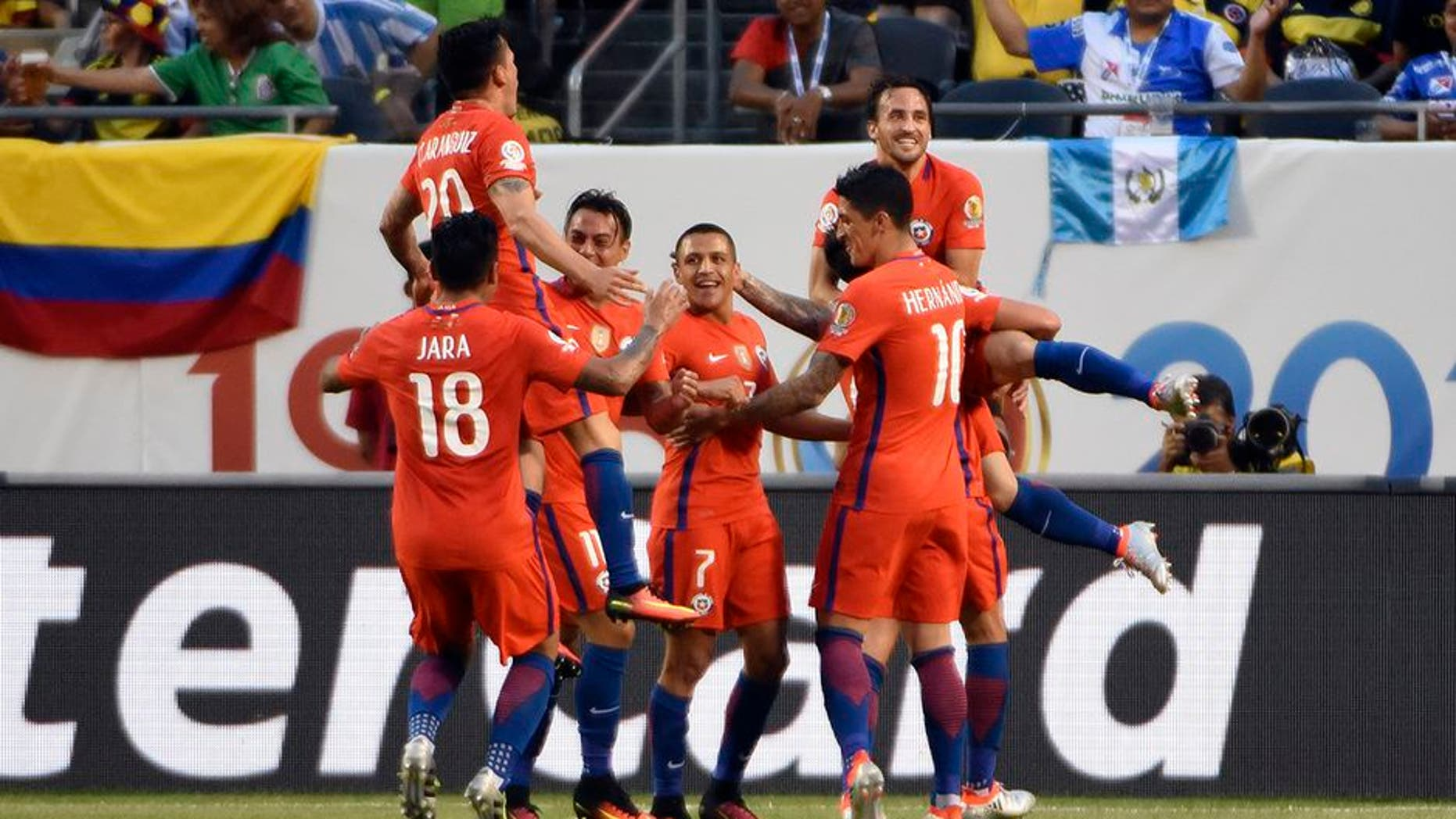 CHICAGO, ILLINOIS - JUNE 22: Jose Pedro Fuenzalida #6 of Chile celebrates with his teamamates after scoring his team's second goal during a Semifinal match between Colombia and Chile at Soldier Field as part of Copa America Centenario US 2016 on June 22, 2016 in Chicago, Illinois, US. (Photo by David Banks/LatinContent/Getty Images)