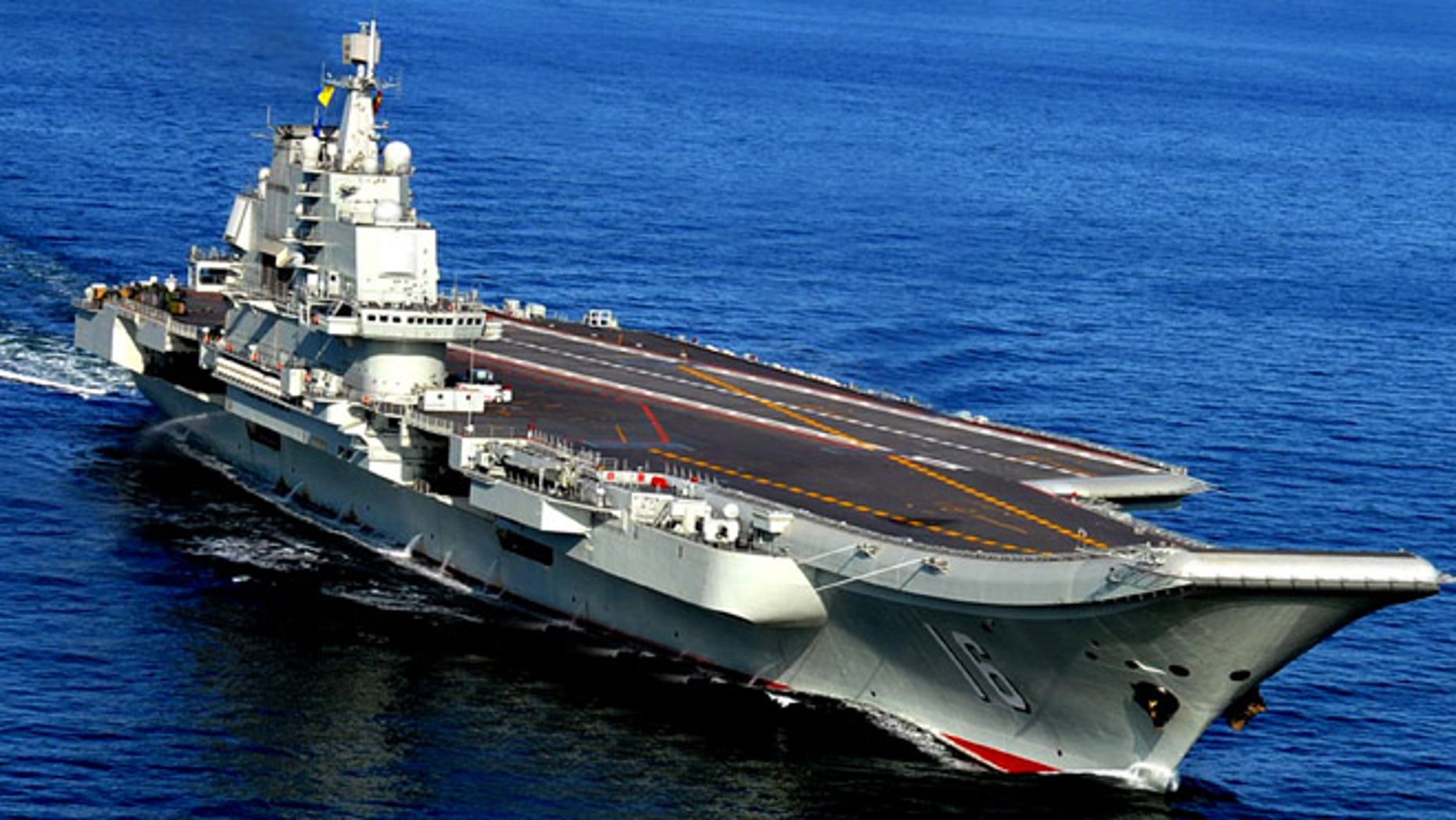 In this Oct. 14, 2012 photo, the Liaoning, China's first aircraft carrier, sails in the sea near Qingdao in eastern China's Shandong province. (AP/Chinatopix)