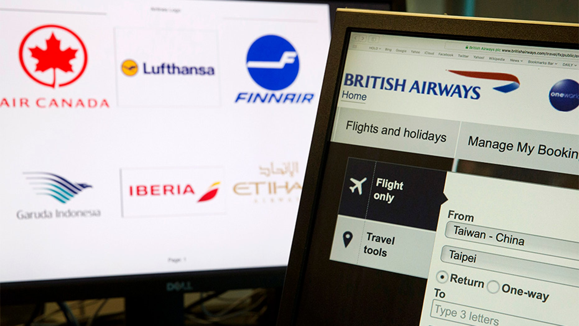 """May 21, 2018: A computer screens display the booking website of British Airways showing """"Taiwan-China"""" in Beijing, China."""